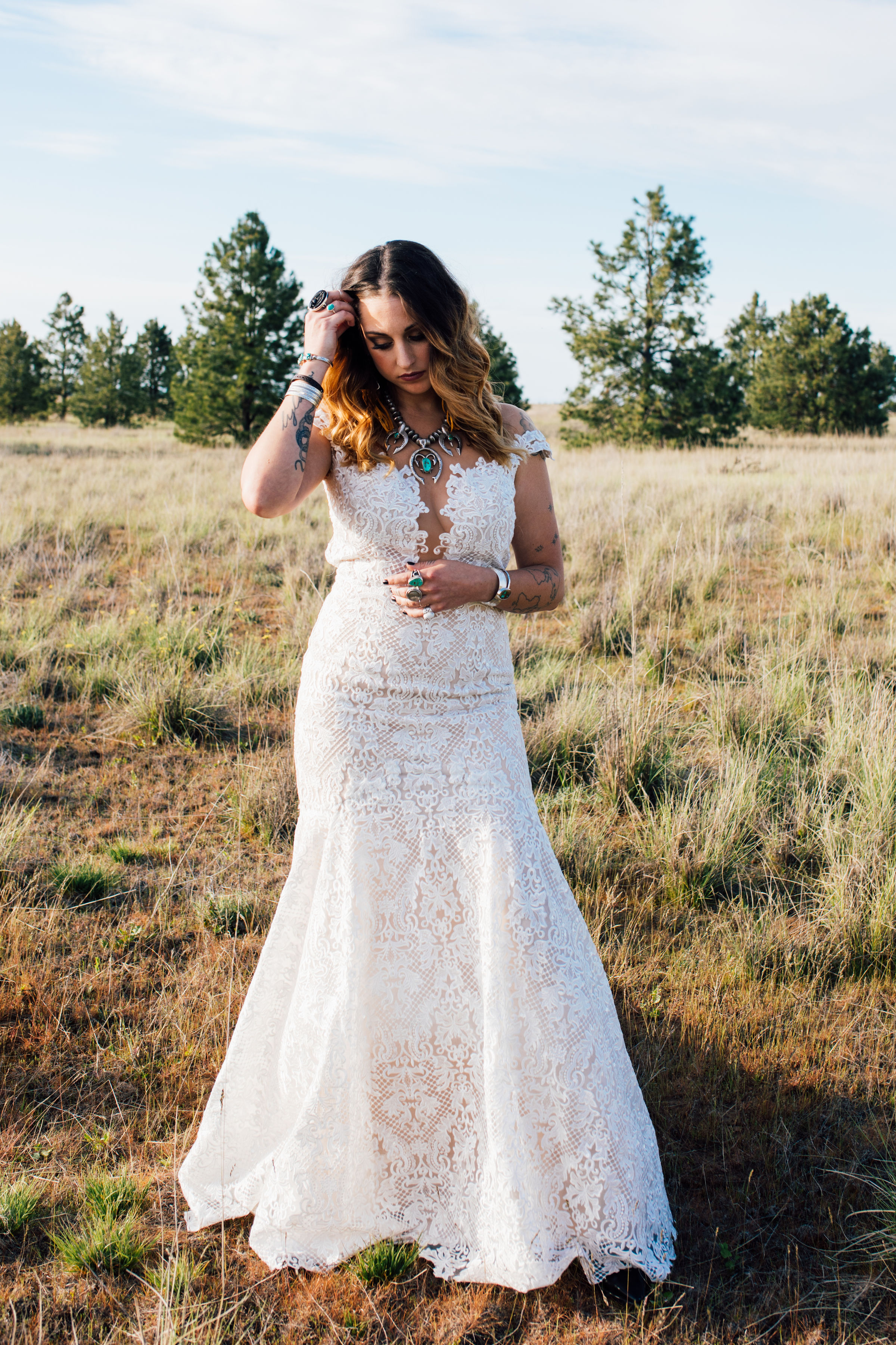 cool elopement spokane wedding dress bride field trees PNW lace