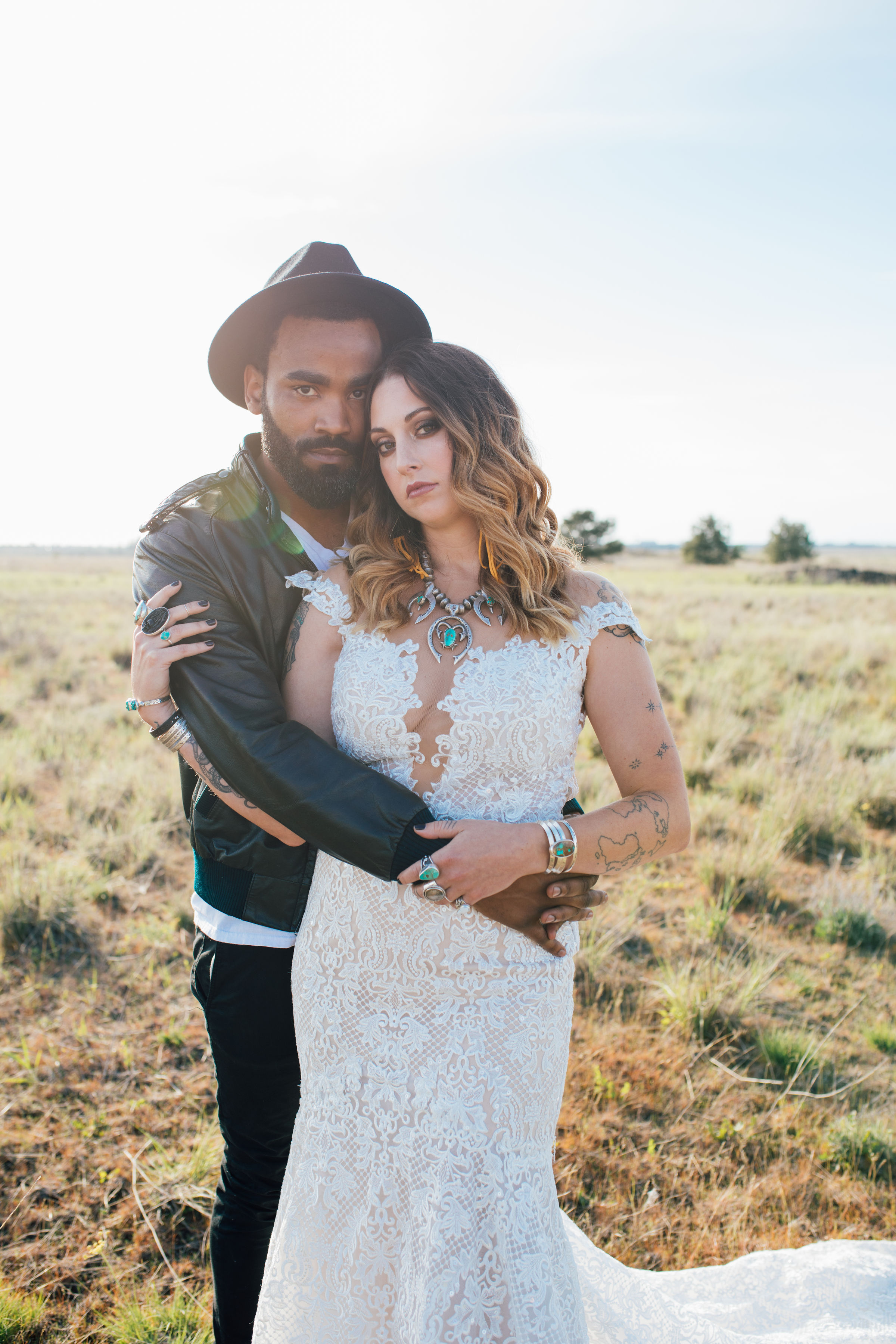 cool elopement spokane wedding holding arm boho floral lace
