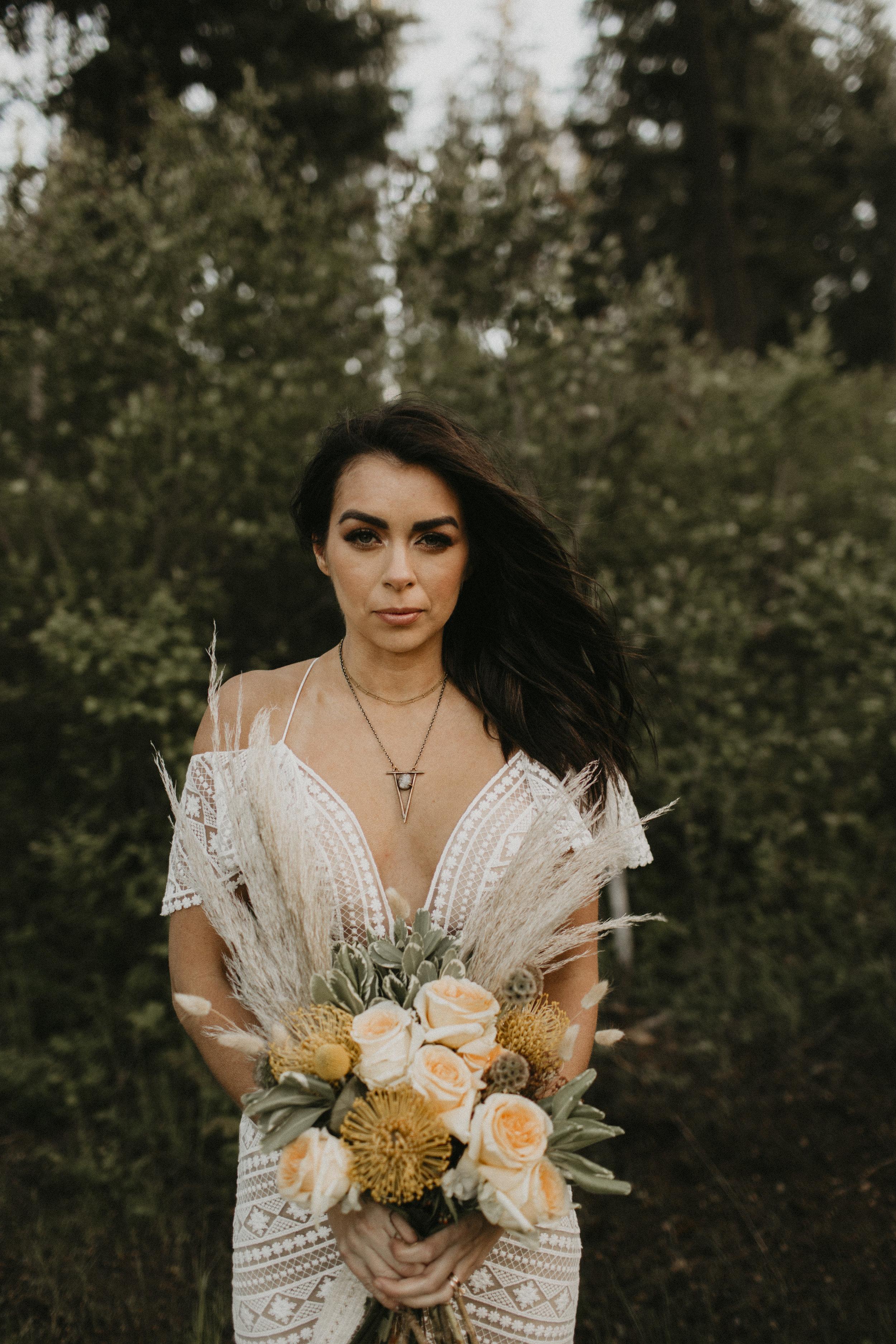 Spokane boho cattle wedding bride flowers outdoors portrait