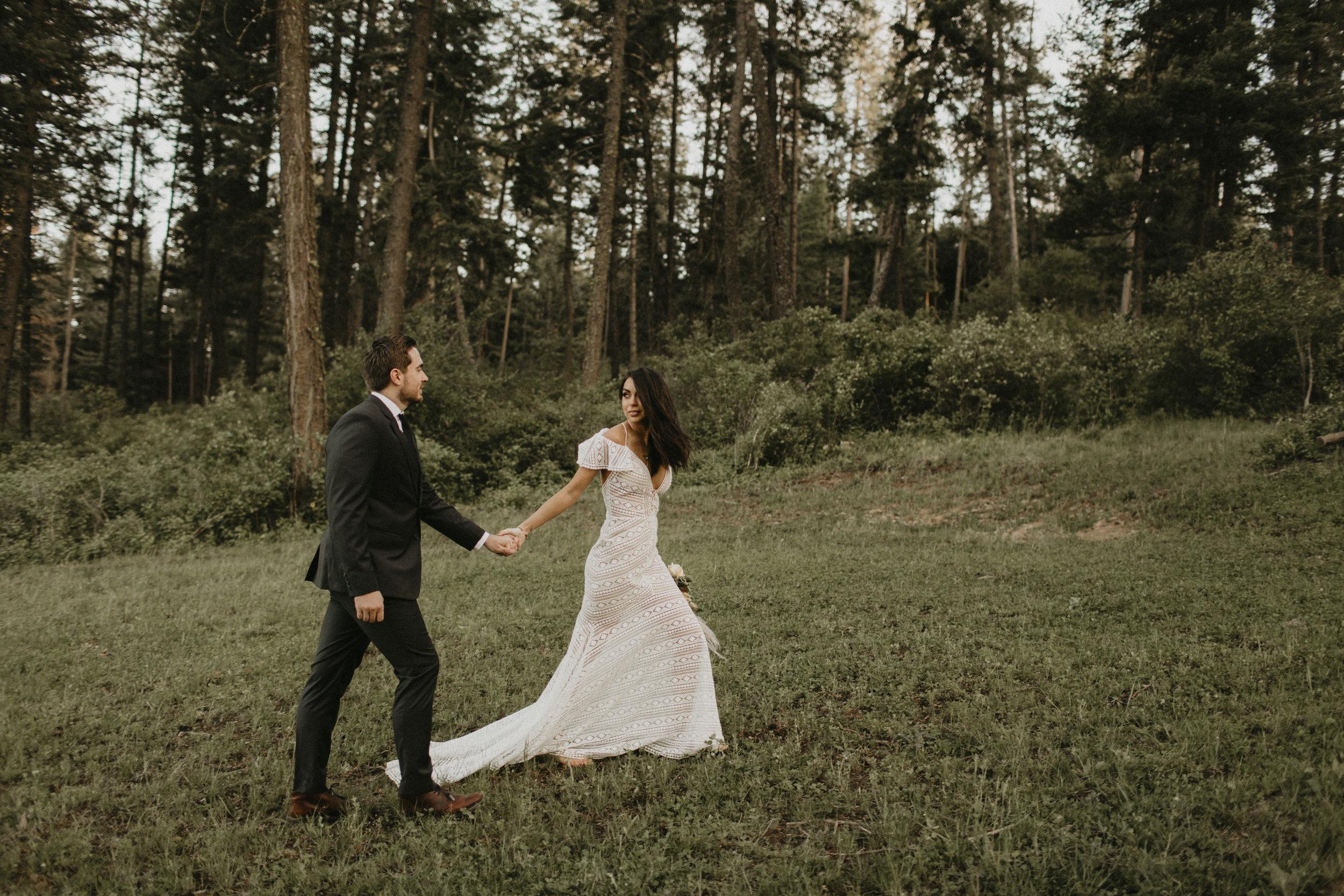 Spokane boho cattle wedding running away elopement bride and groom