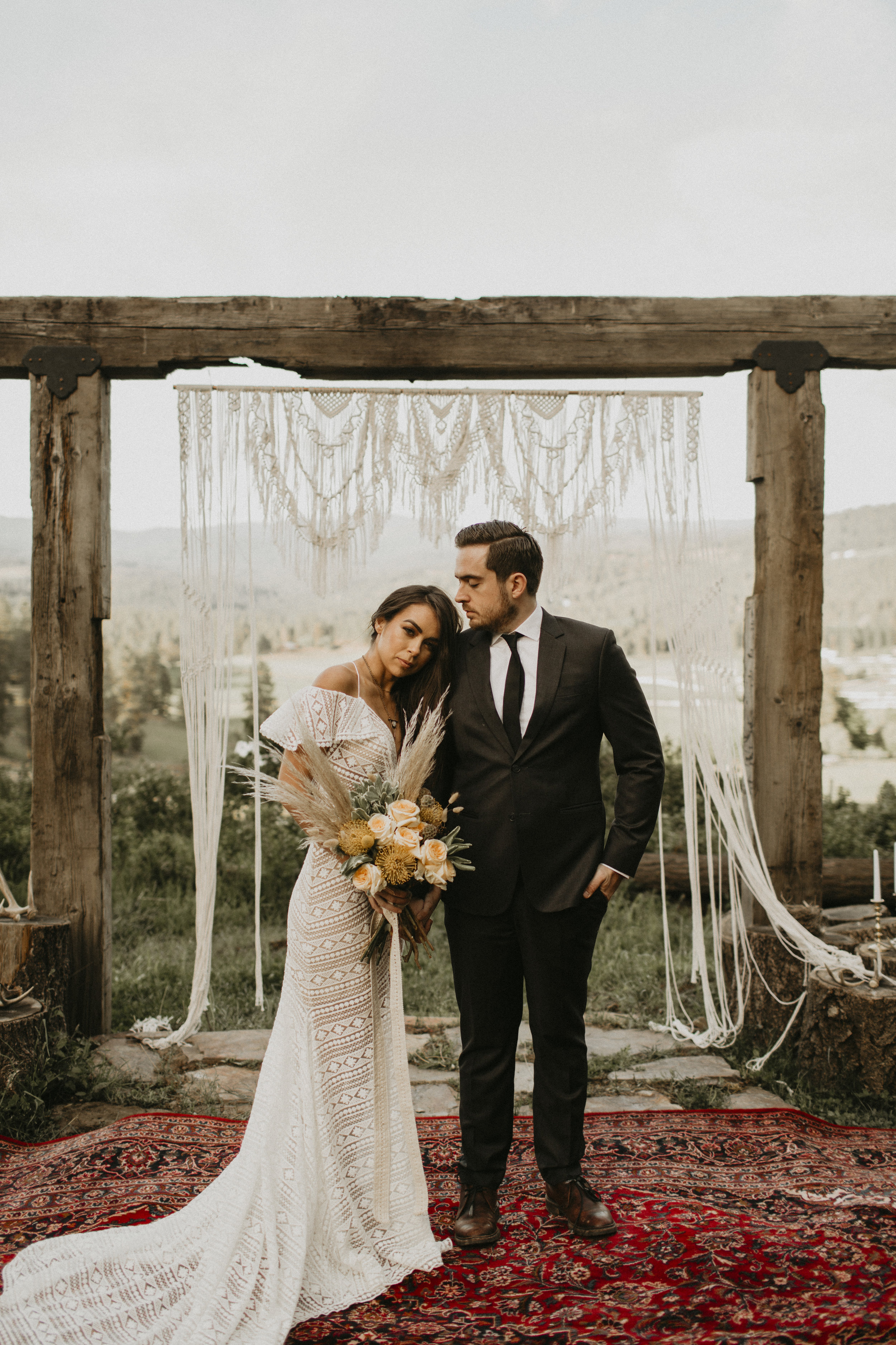 Spokane boho cattle wedding bridal bouquet Persian rug woods rustic ceremony