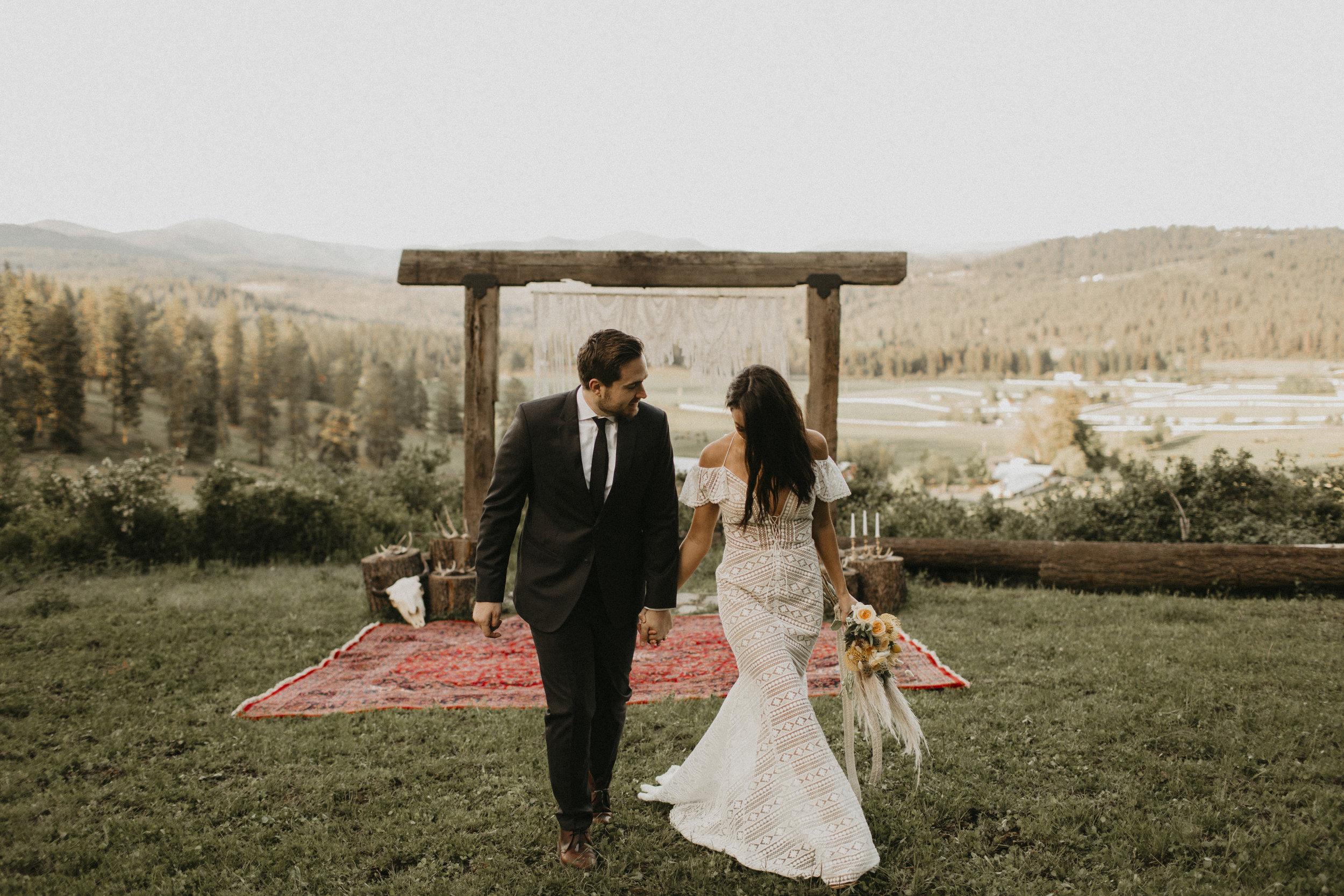 Spokane boho cattle wedding exit just married walking leaving