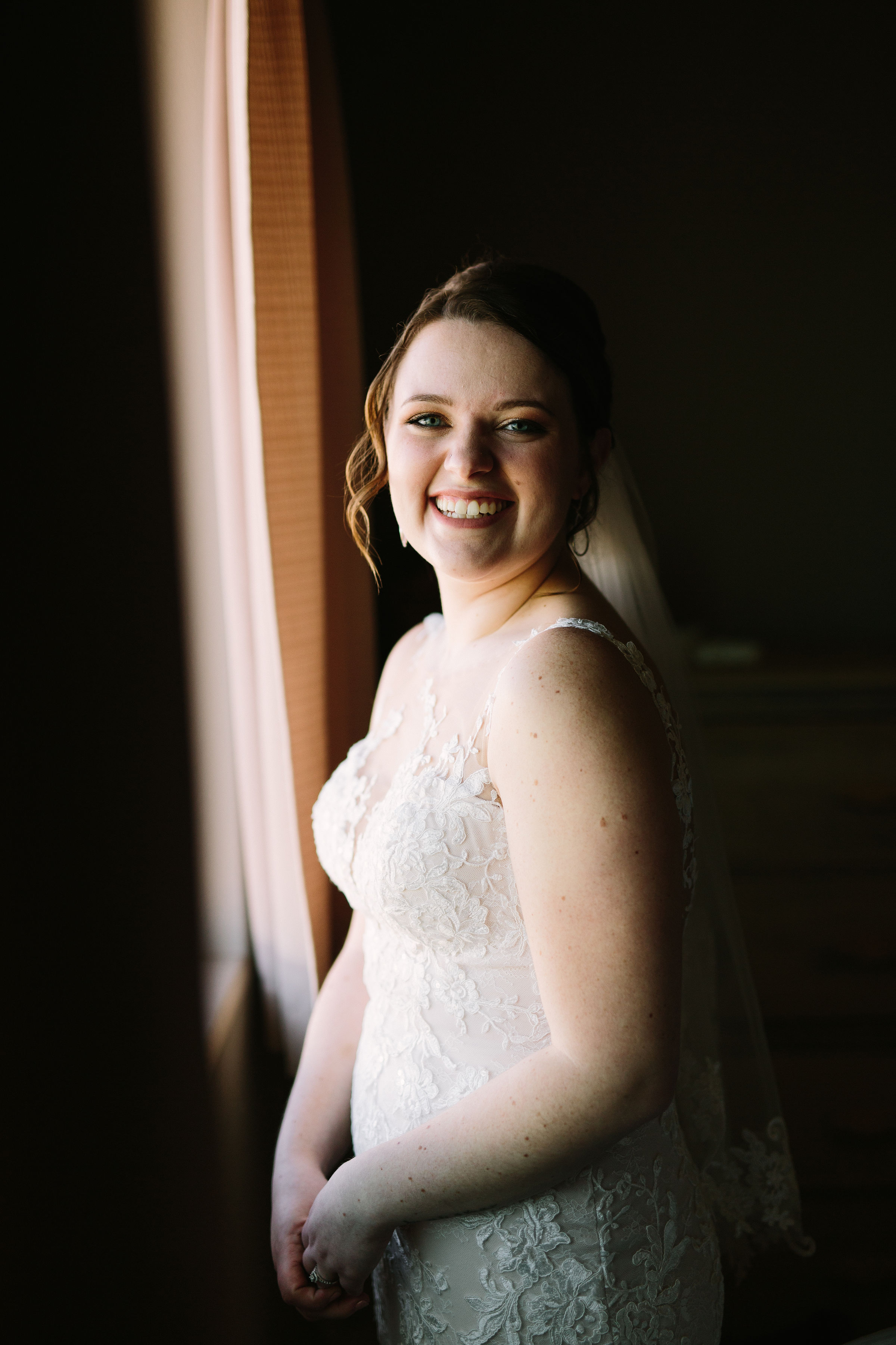 Fun Rustic spokane wedding bride smiling veil wedding dress ready