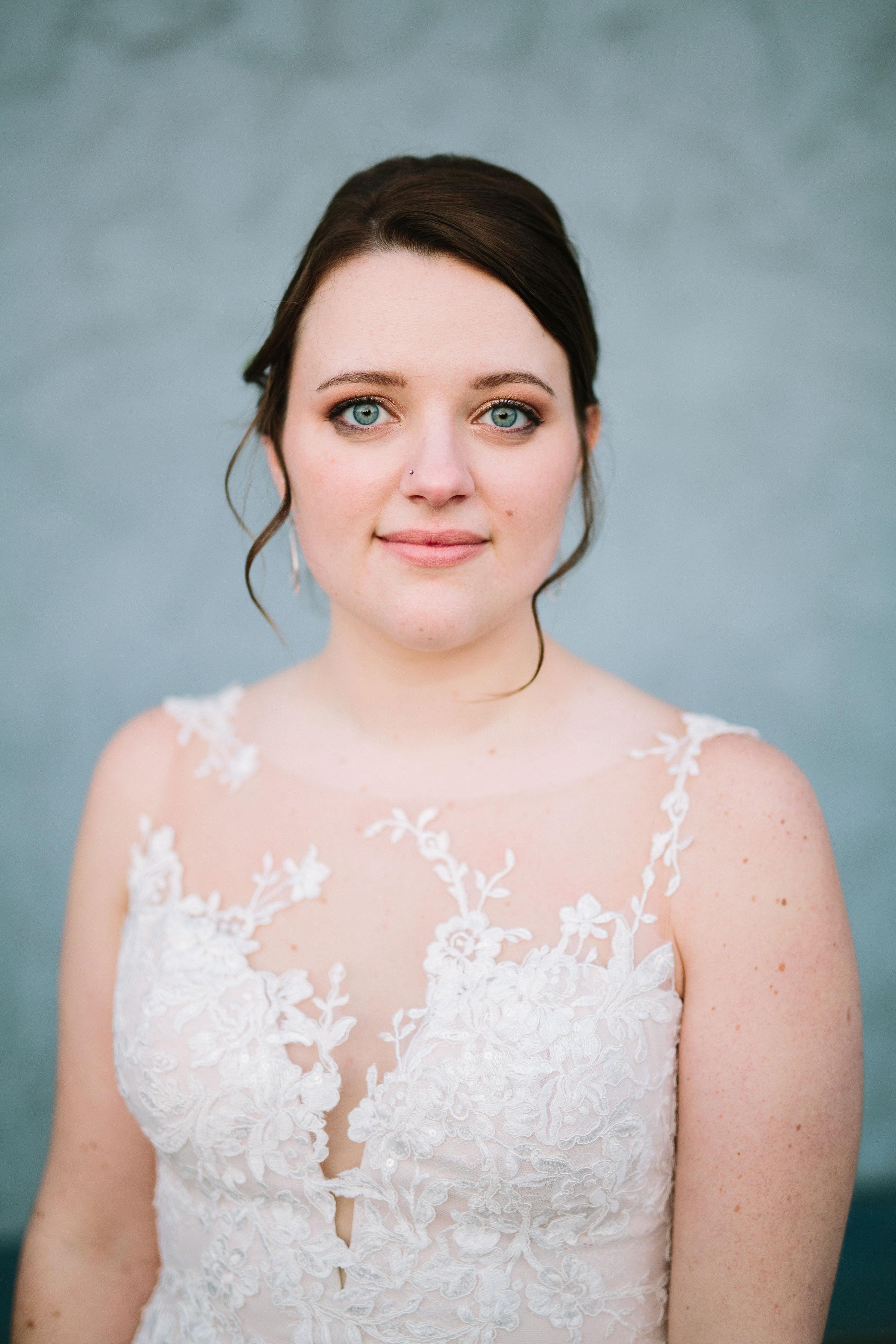 Fun Rustic spokane wedding portrait bride nose ring blue eyes up-do hair