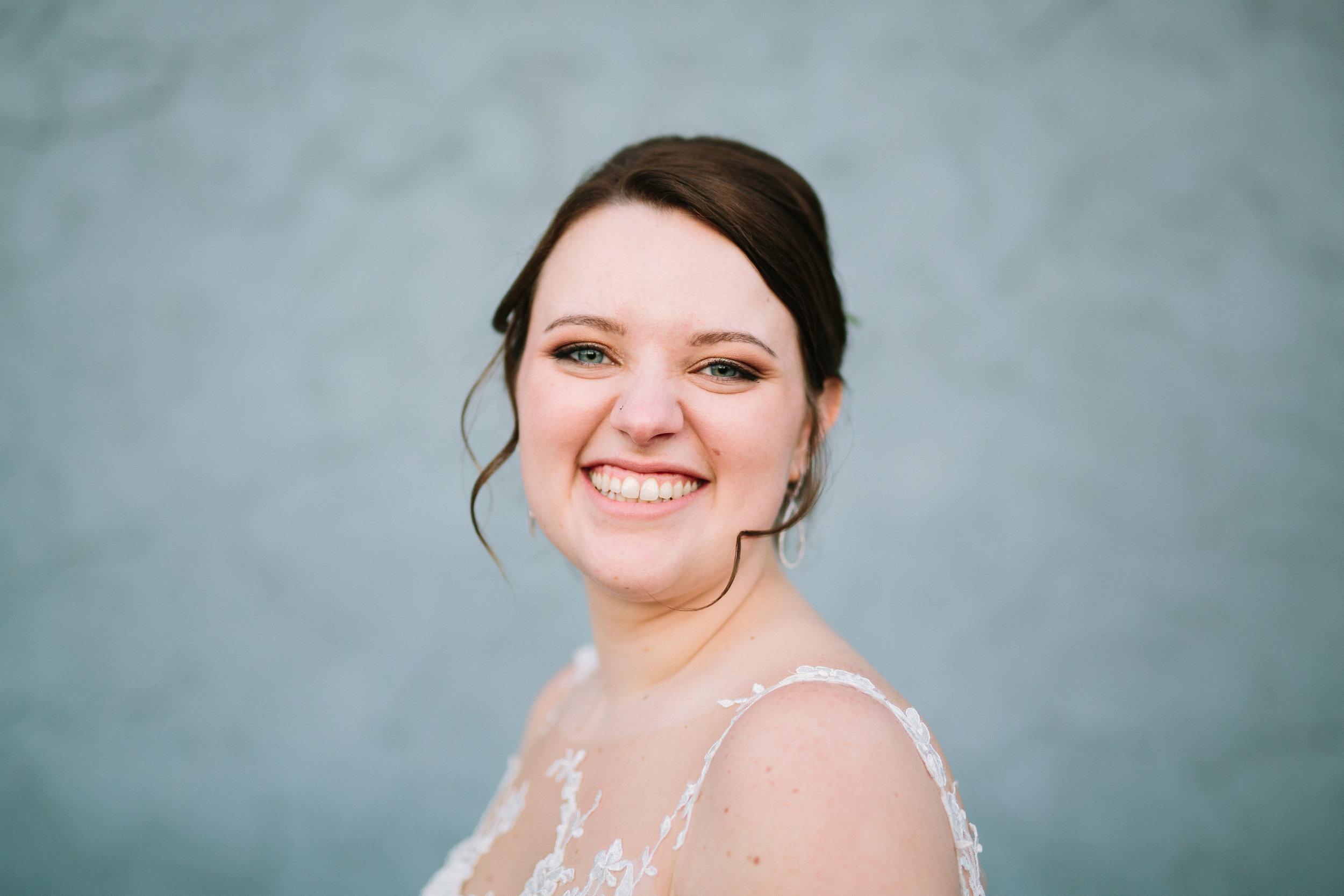 Fun Rustic spokane wedding curly hair laughing giggling against wall