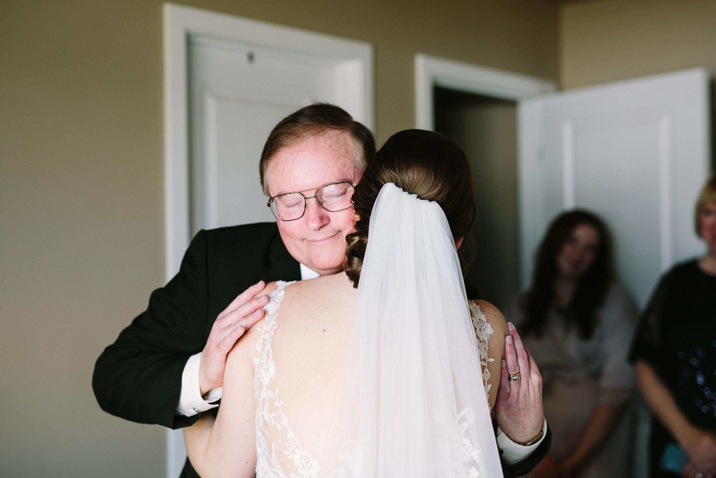Fun Rustic spokane wedding dad hugging bride content wedding veil
