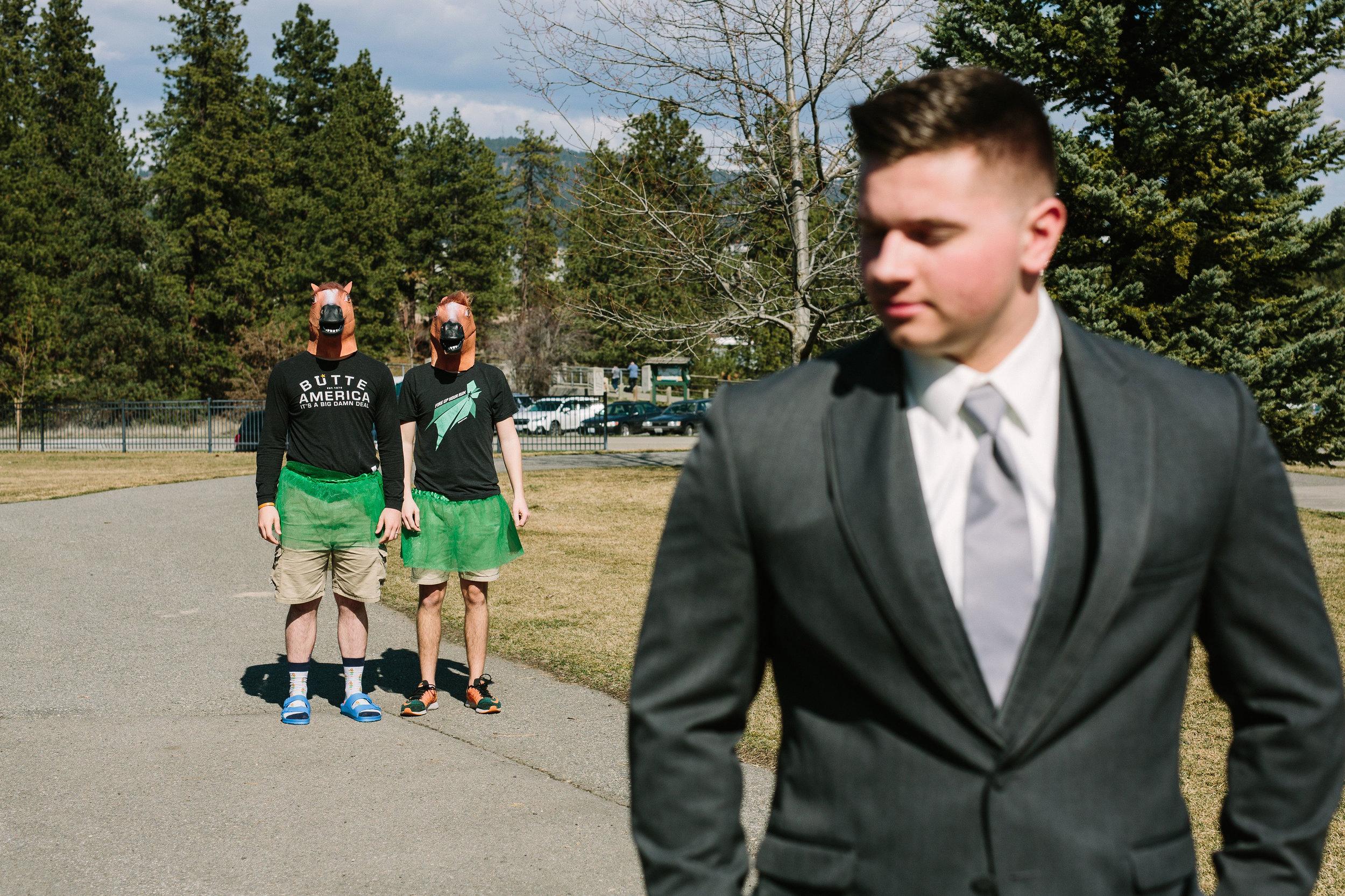 Fun Rustic spokane wedding first look best man pulling prank on groom funny