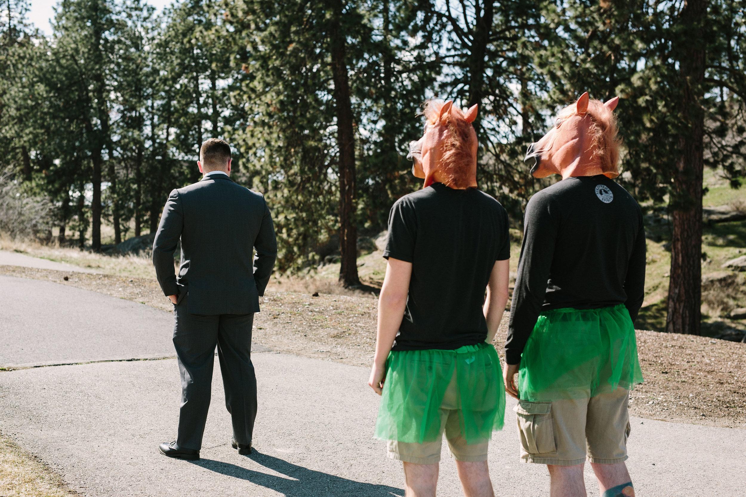 Fun Rustic spokane wedding groom laughing horse mask prank