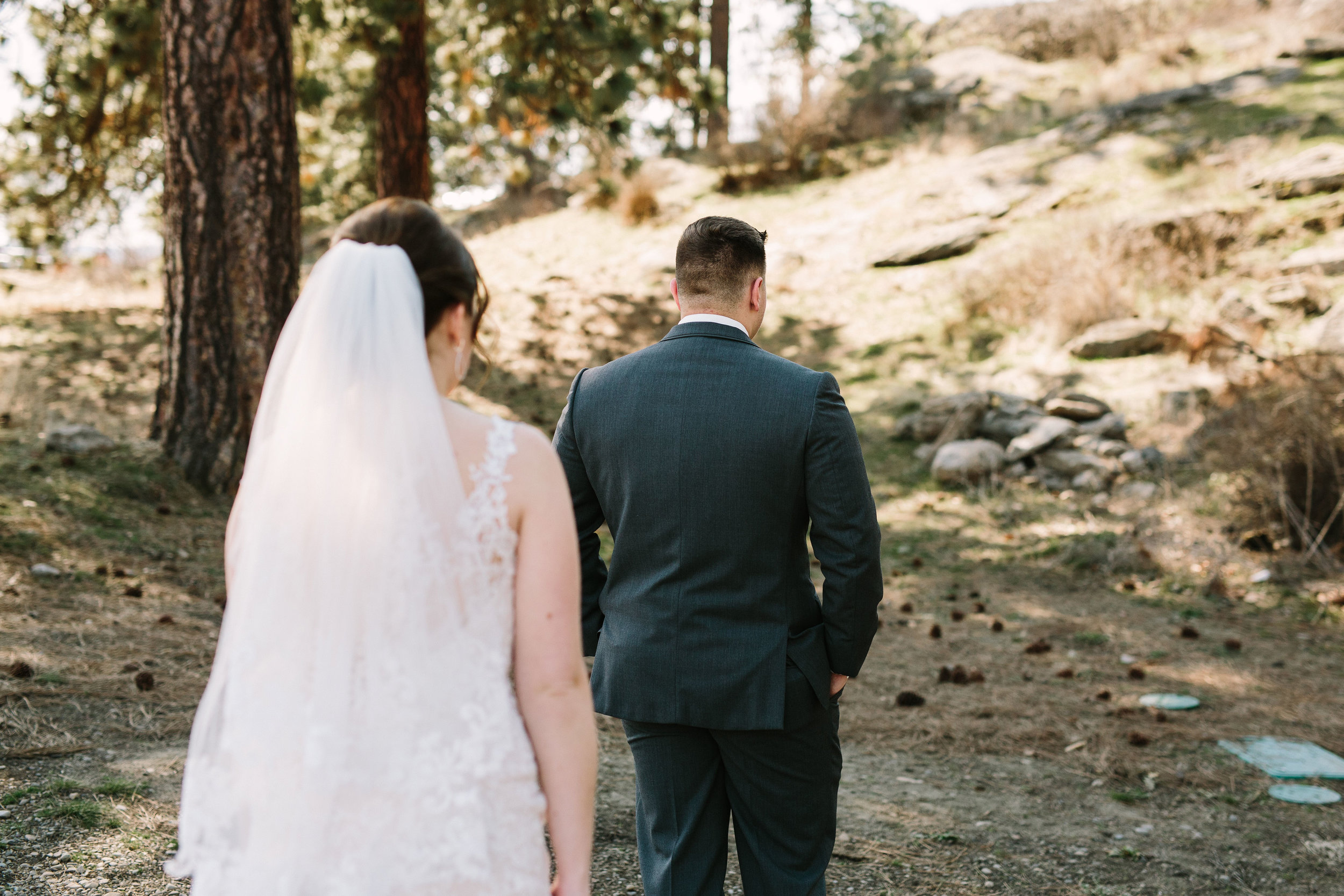 Fun Rustic spokane wedding first look in woods