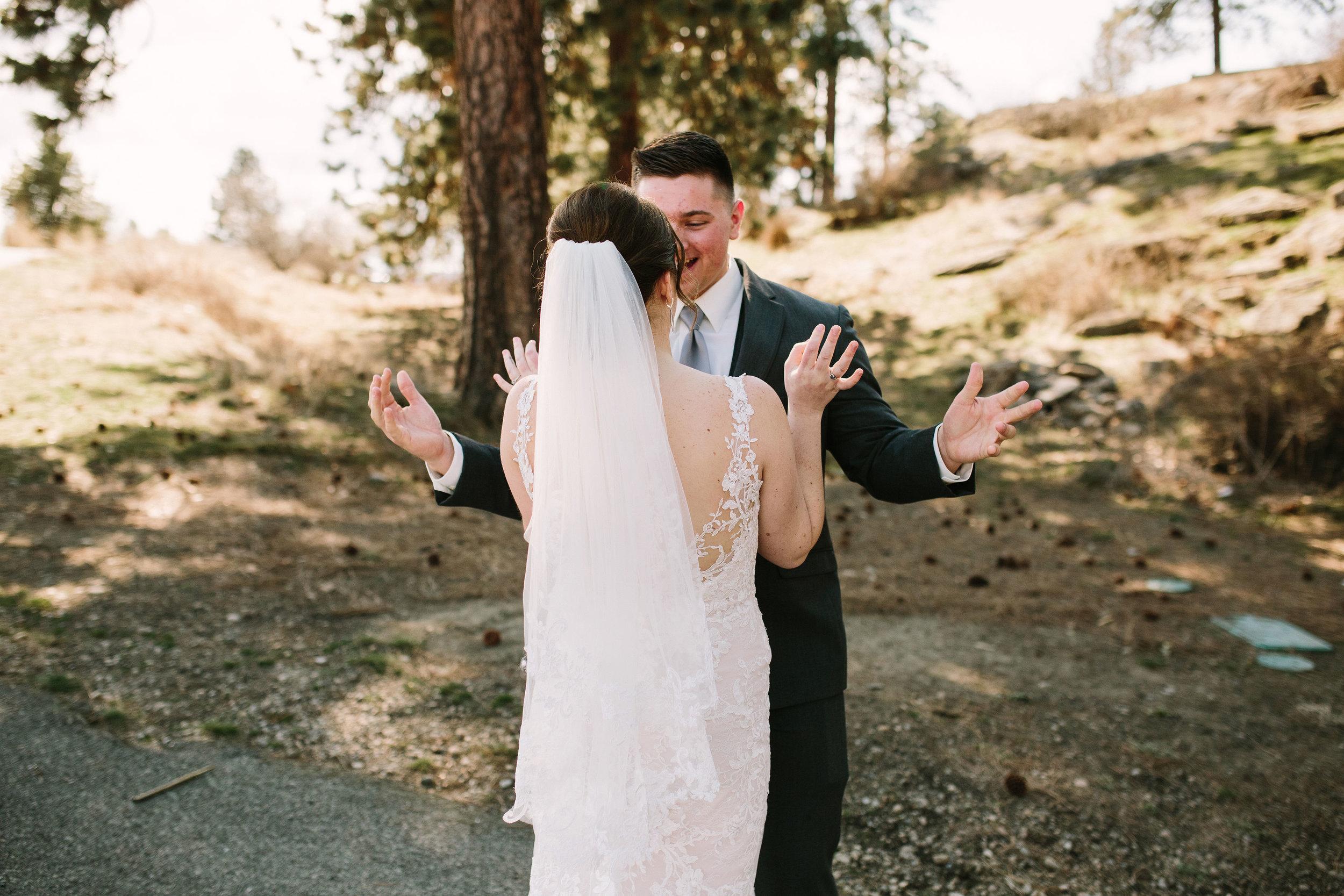 Fun Rustic spokane wedding groom happy to see bride first reaction surprised