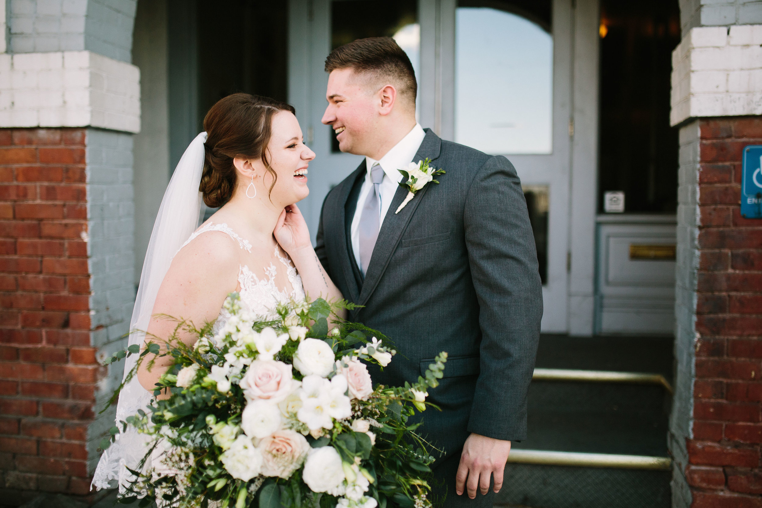 Fun Rustic spokane wedding groom and bride laughing together outside