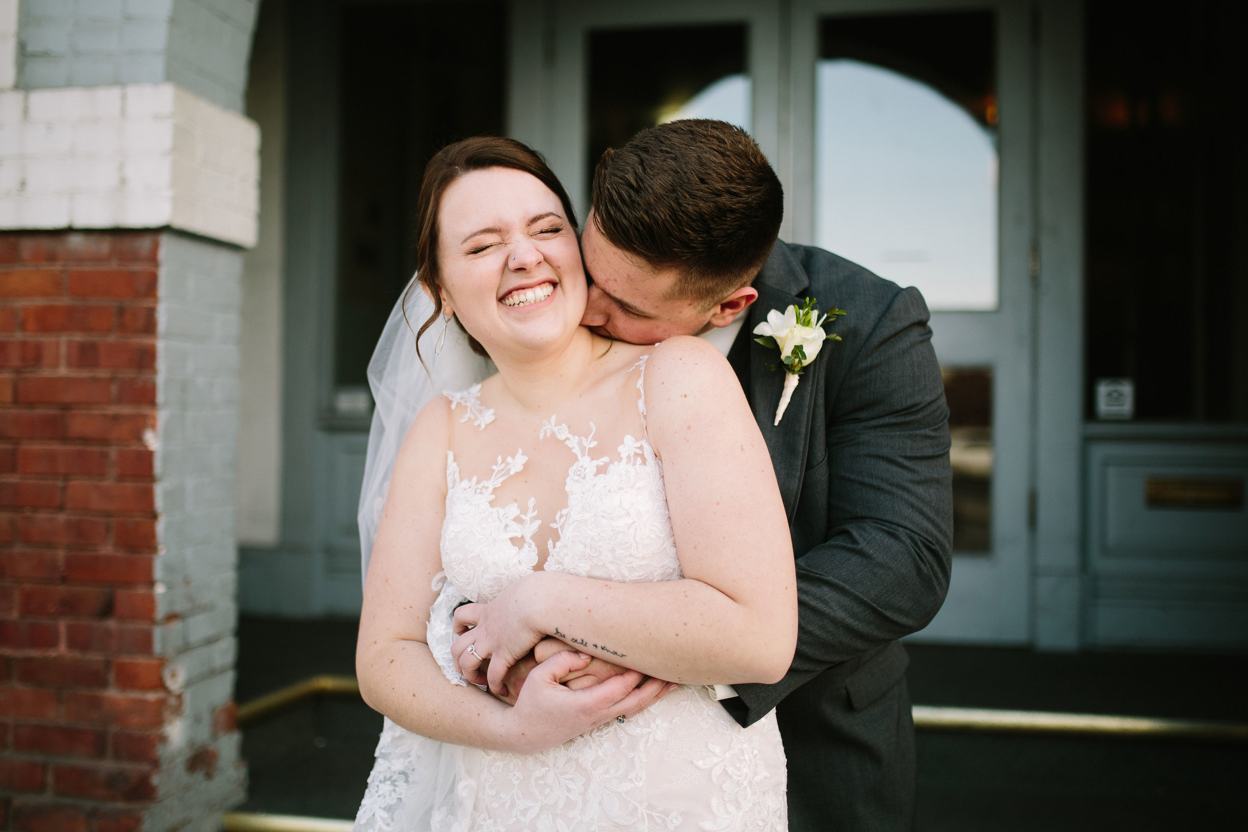 Fun Rustic spokane wedding groom kissing brides neck making her laugh