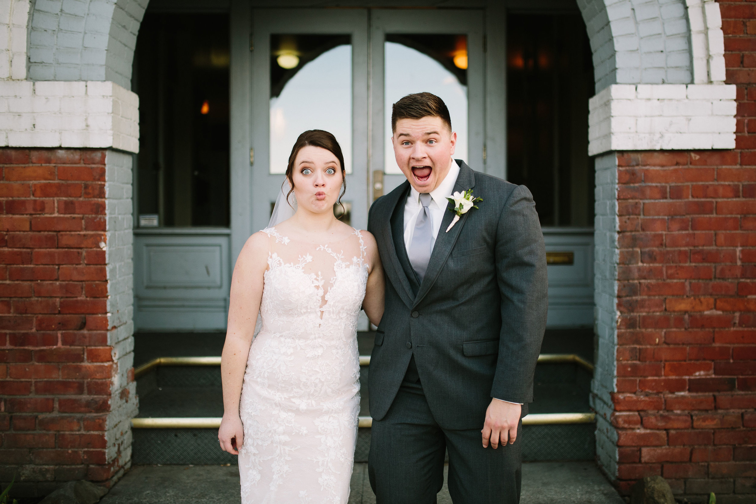 Fun Rustic spokane wedding silly faces outside of court house giddy bride and groom