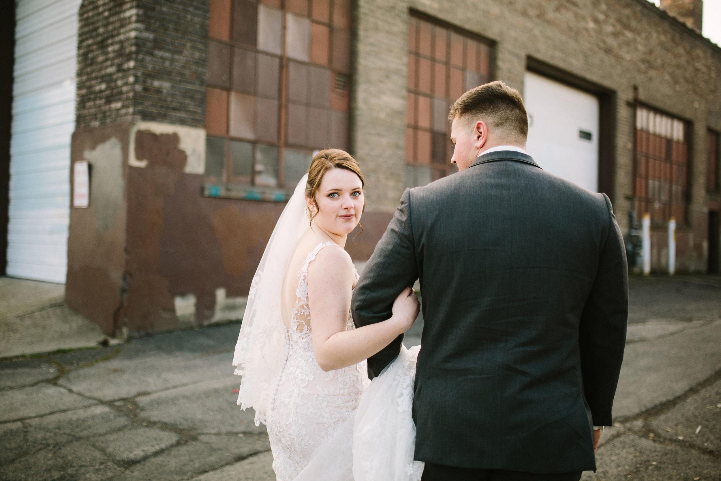 Fun Rustic spokane wedding bride and groom walking away together