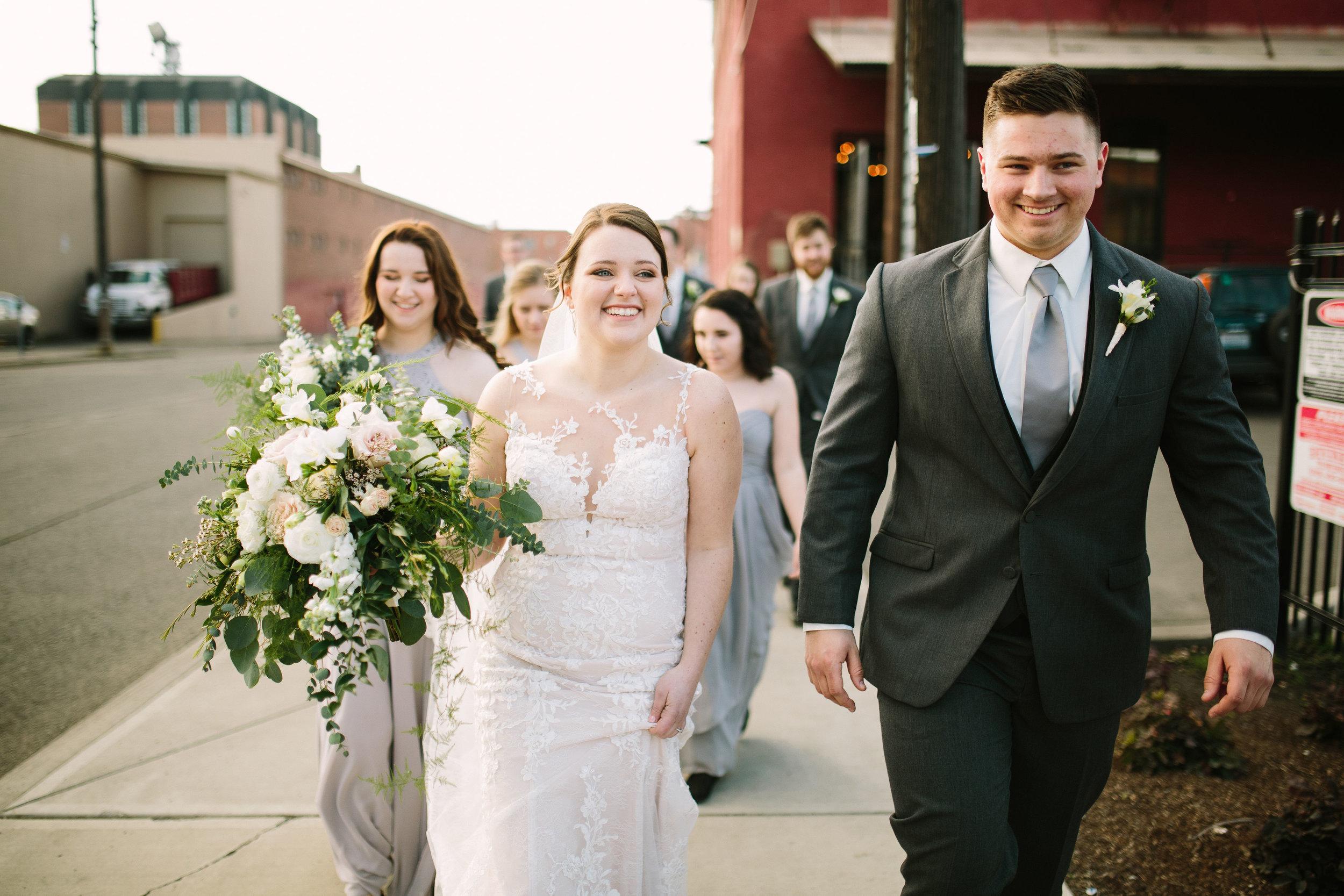Fun Rustic spokane wedding bridal party walking together happy