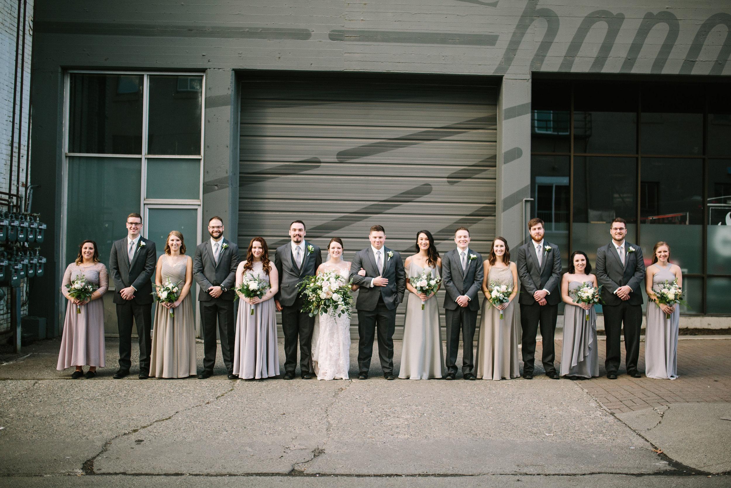 Fun Rustic spokane wedding bridal party standing together before wedding