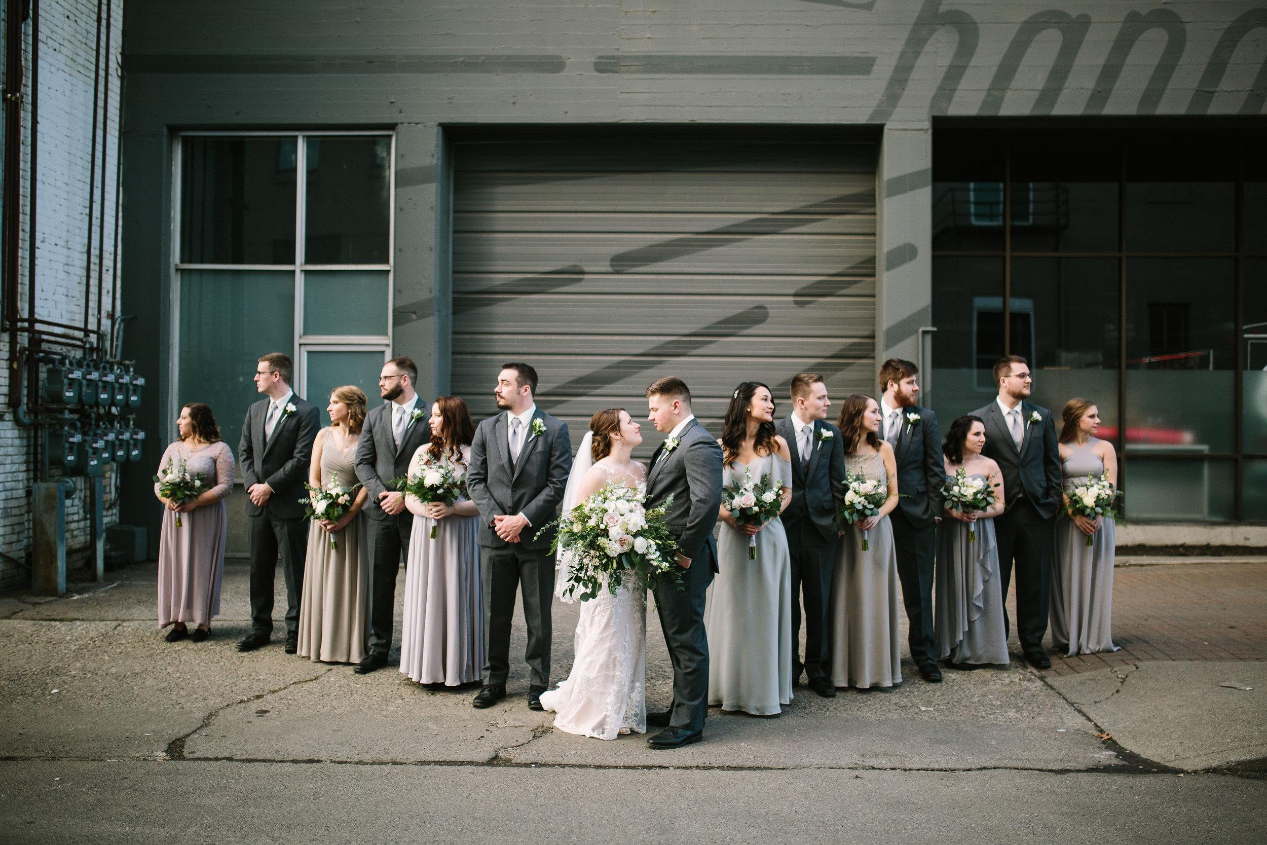 Fun Rustic spokane wedding pictures couple looking bridesmaids groomsmen look away