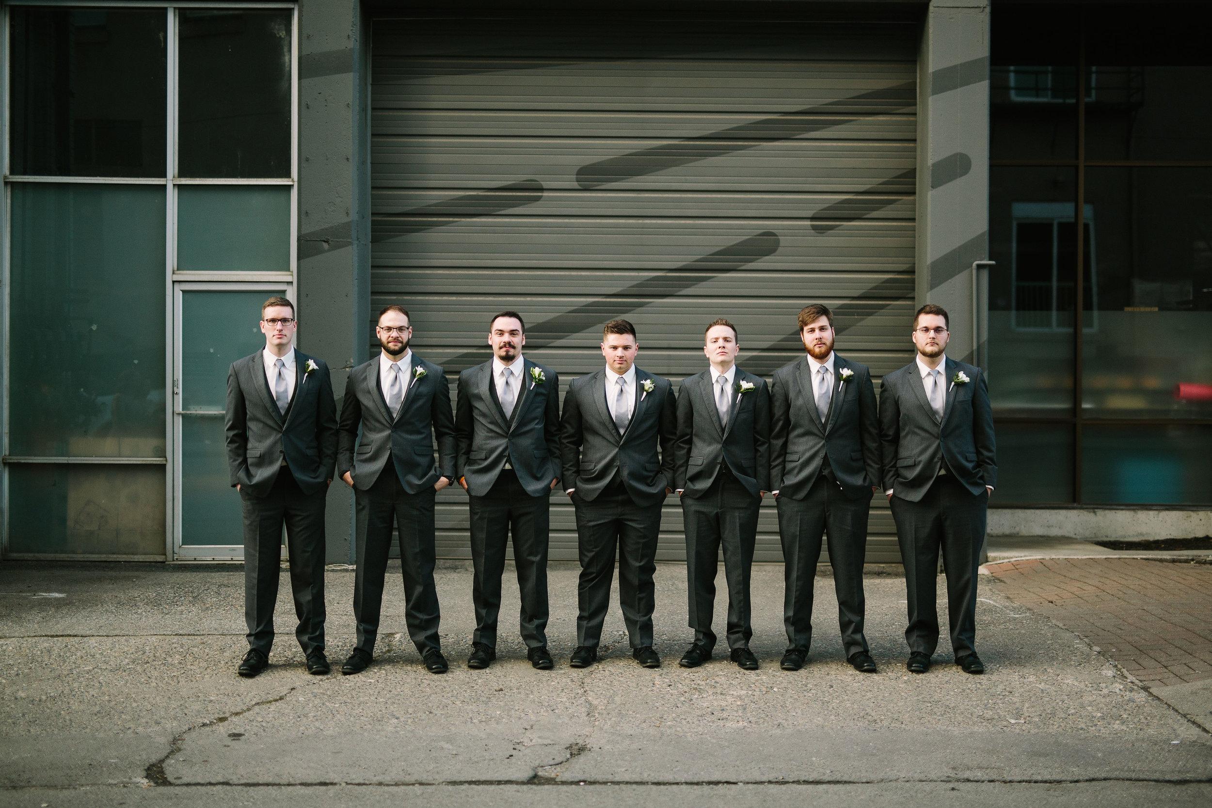 Fun Rustic spokane wedding groomsmen photo together standing side by side