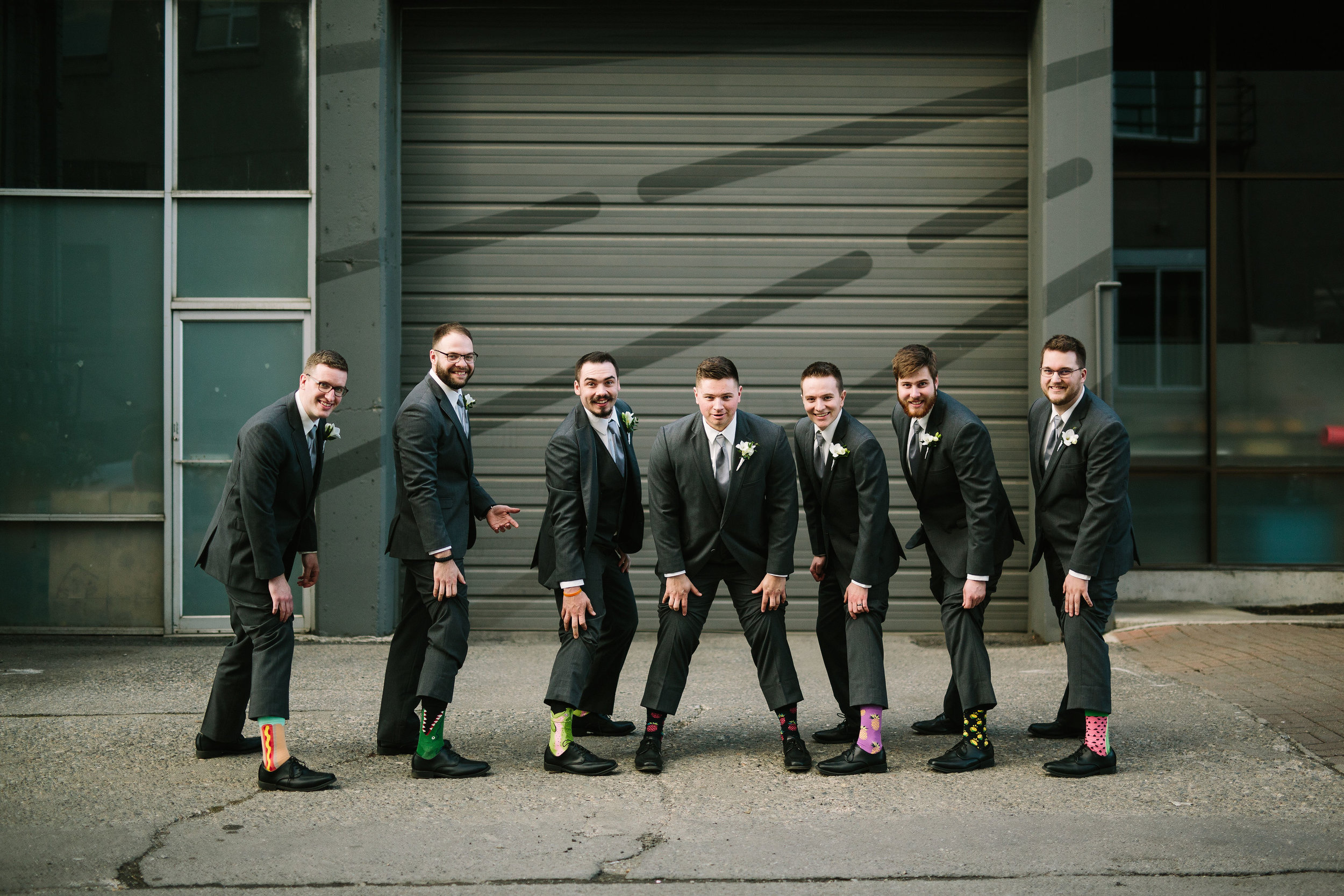 Fun Rustic spokane wedding groom and groomsmen showing off socks fun socks