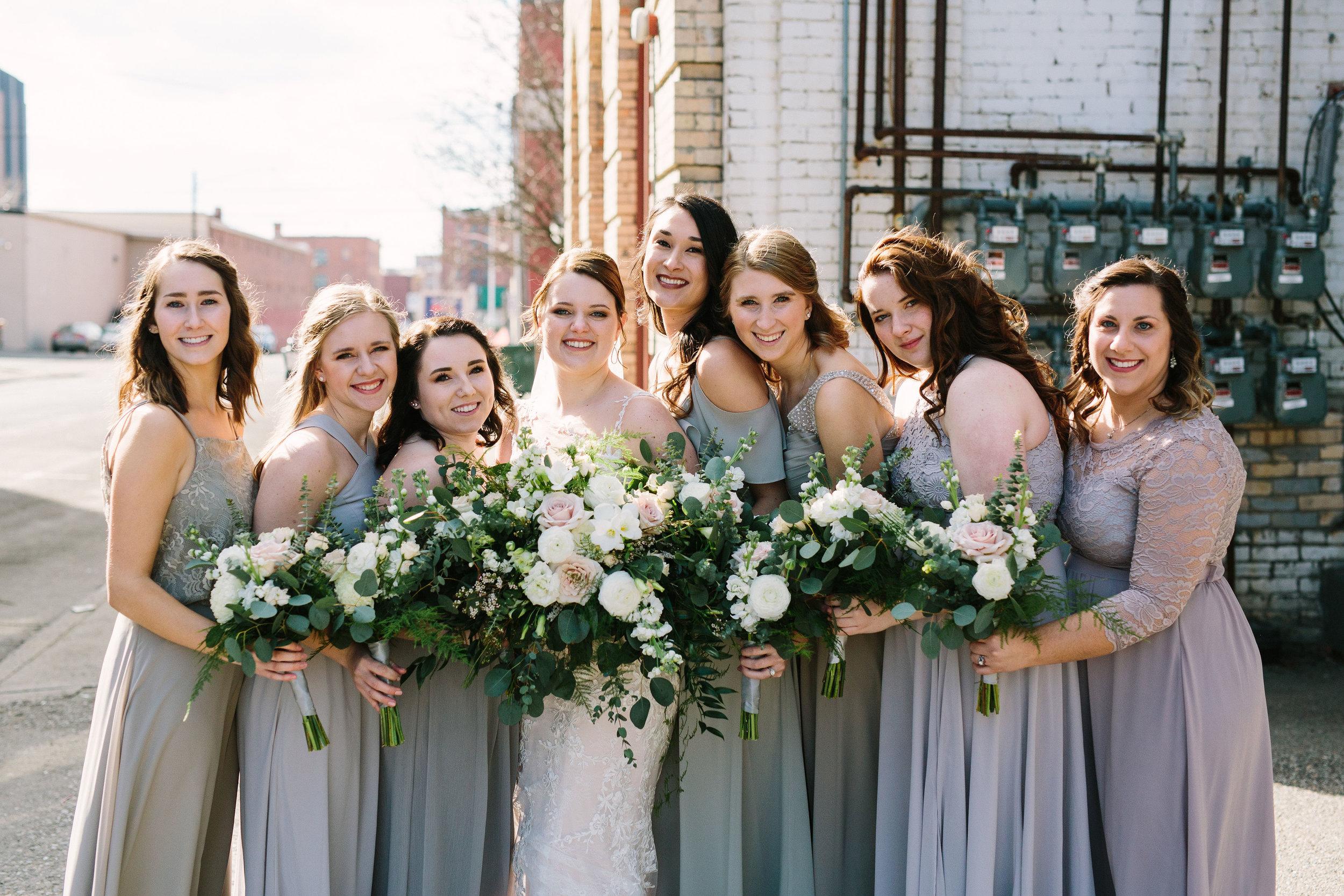 Fun Rustic spokane wedding bridesmaids together bride flower bouquets