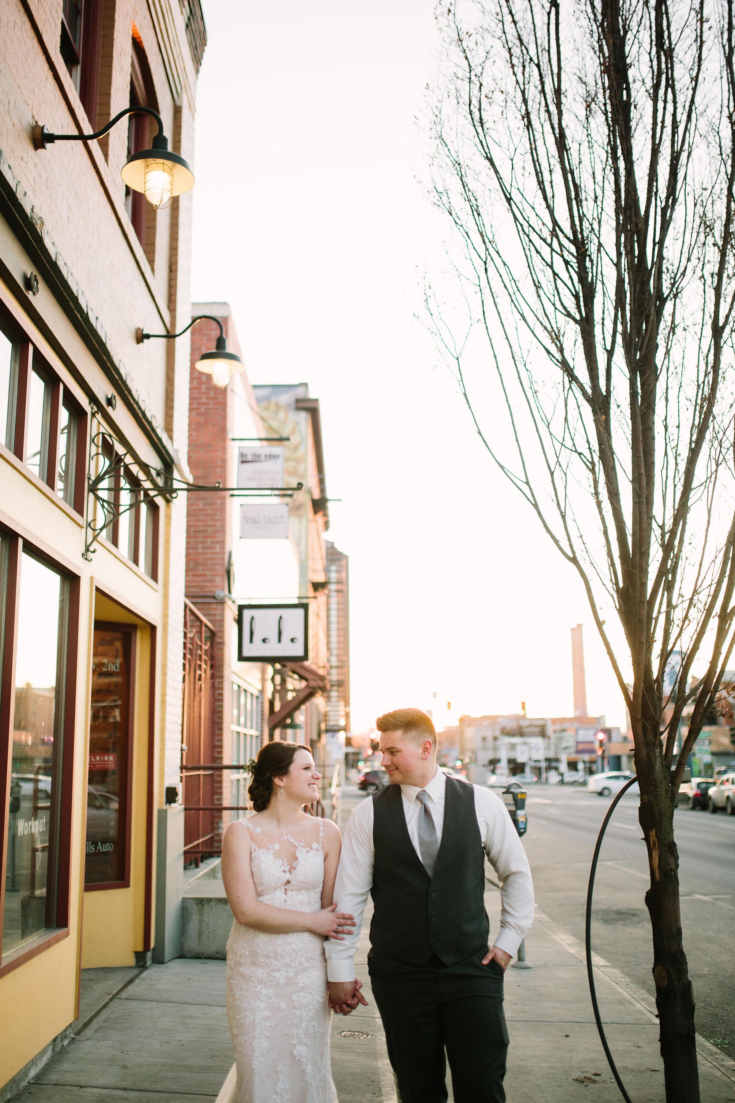 Fun Rustic spokane wedding bride holding groom smiling happy