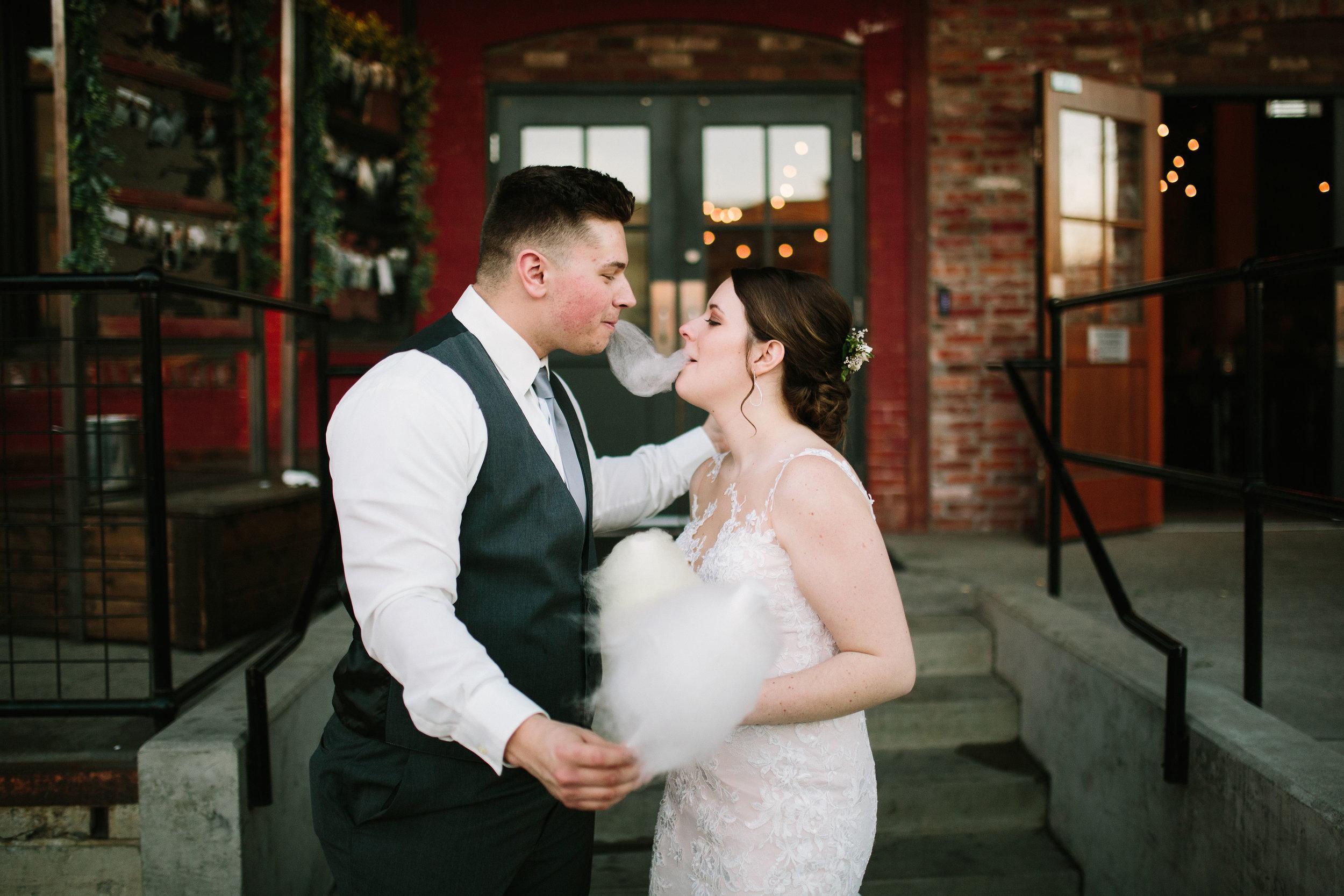 Fun Rustic spokane wedding bride groom sharing cotton candy