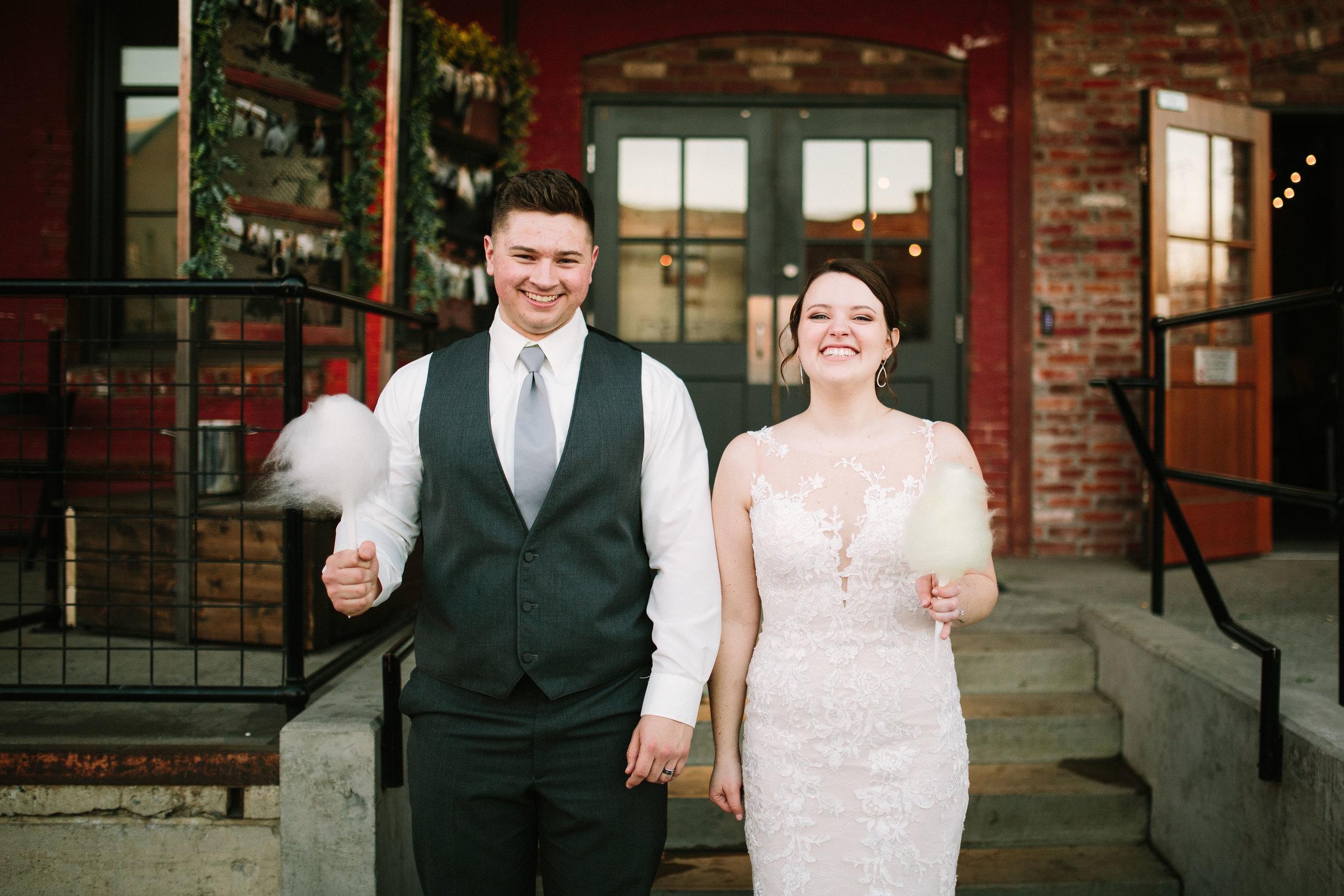 Fun Rustic spokane wedding smiling standing together wedding day cheesing