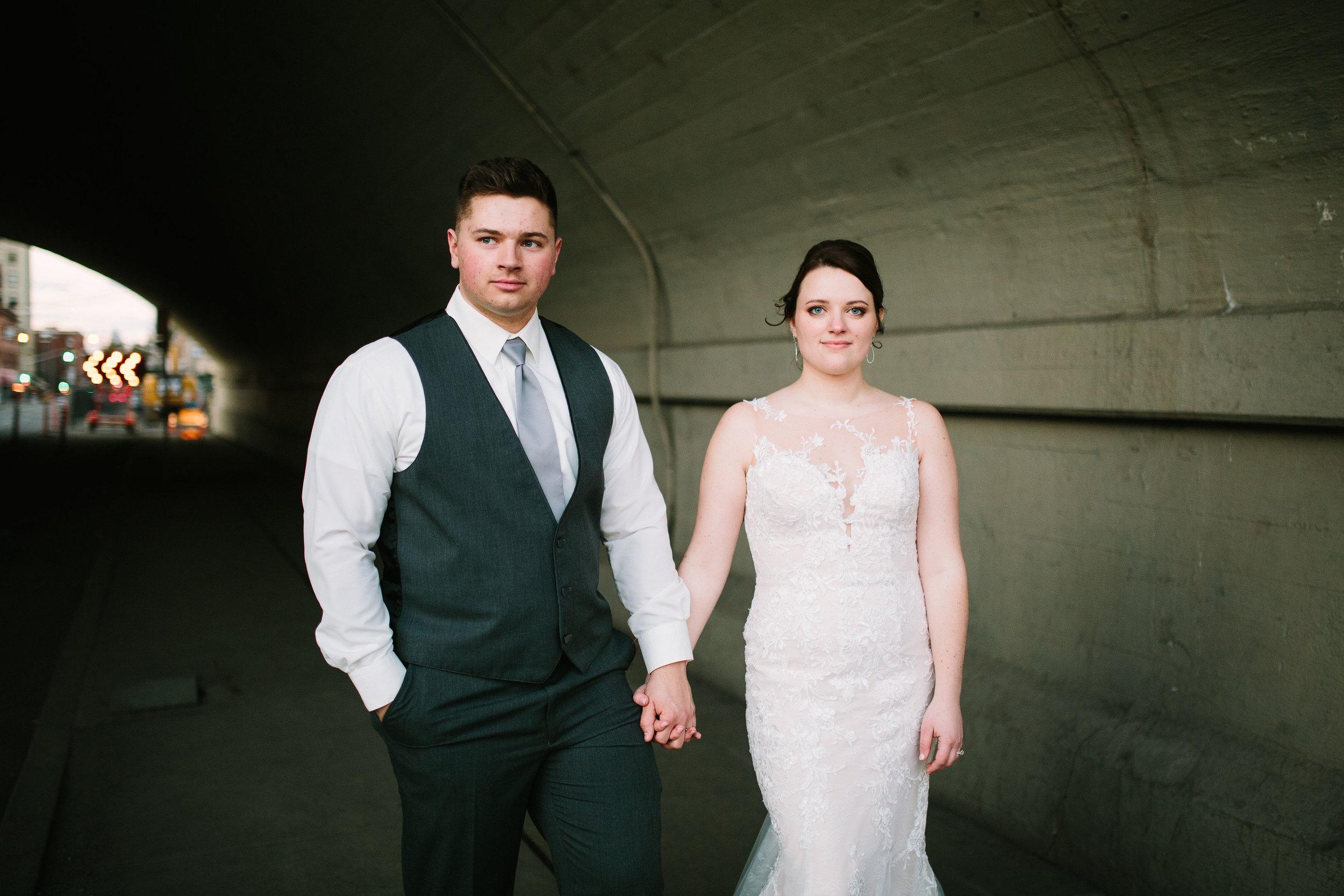 Fun Rustic spokane wedding bride groom standing tunnel cool picture holding hands