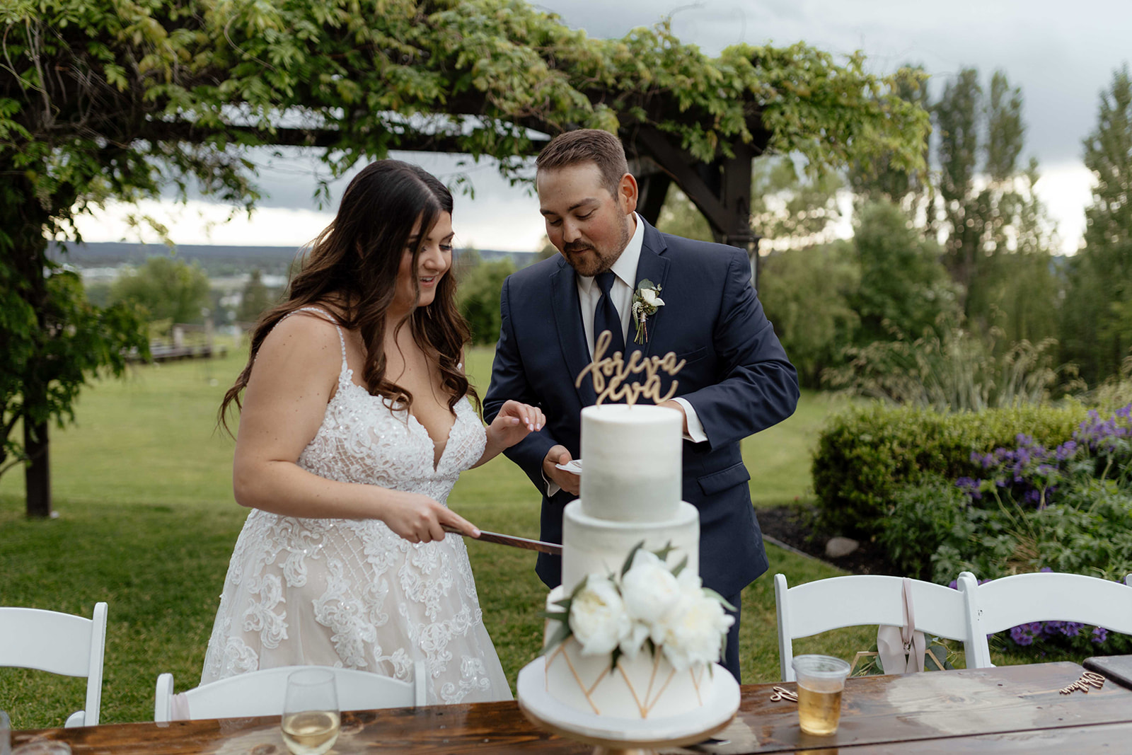 beacon hill wedding honest in ivory dress spokane cake cutting
