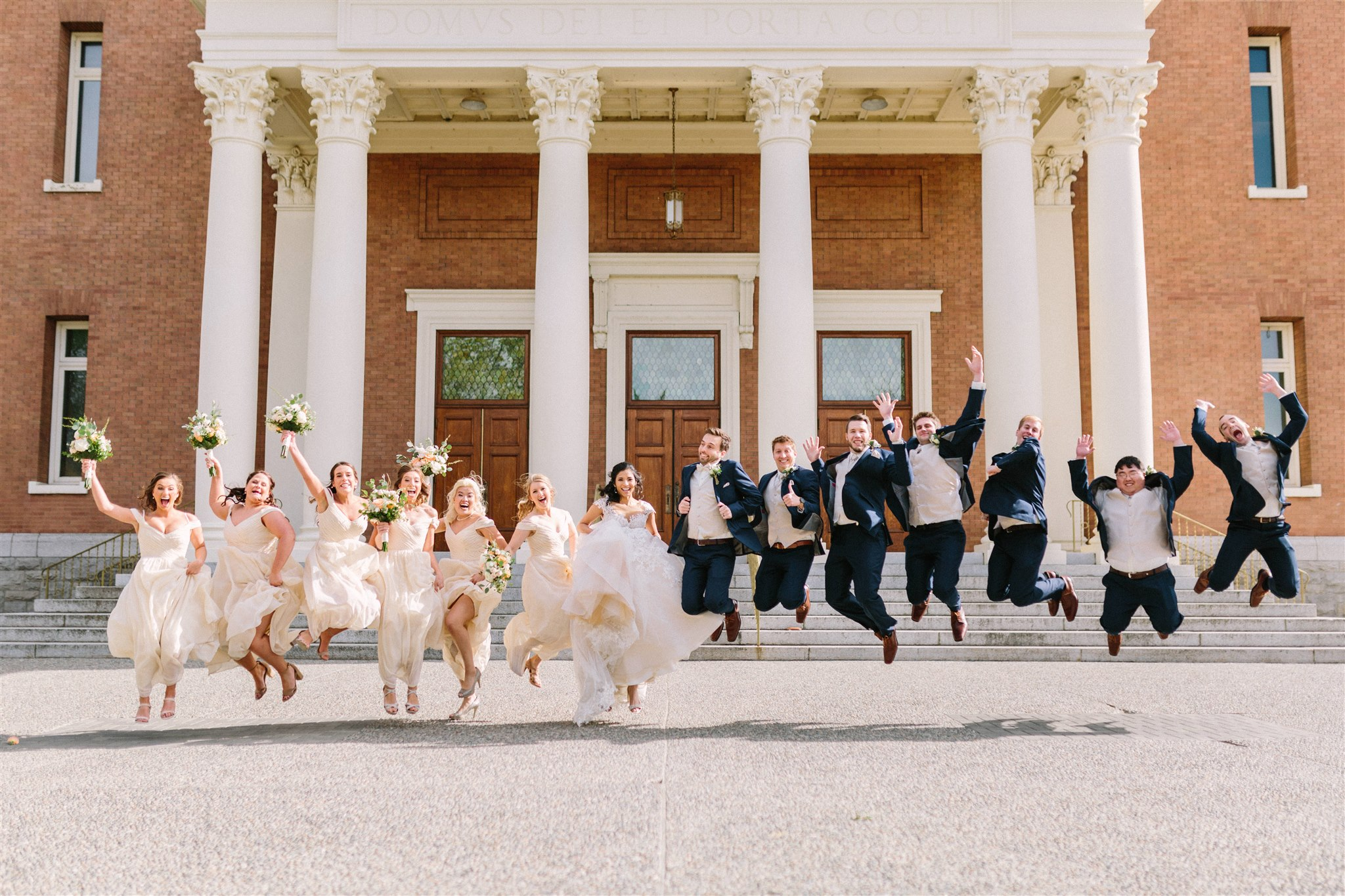 happy jumping wedding party picture spokane couple