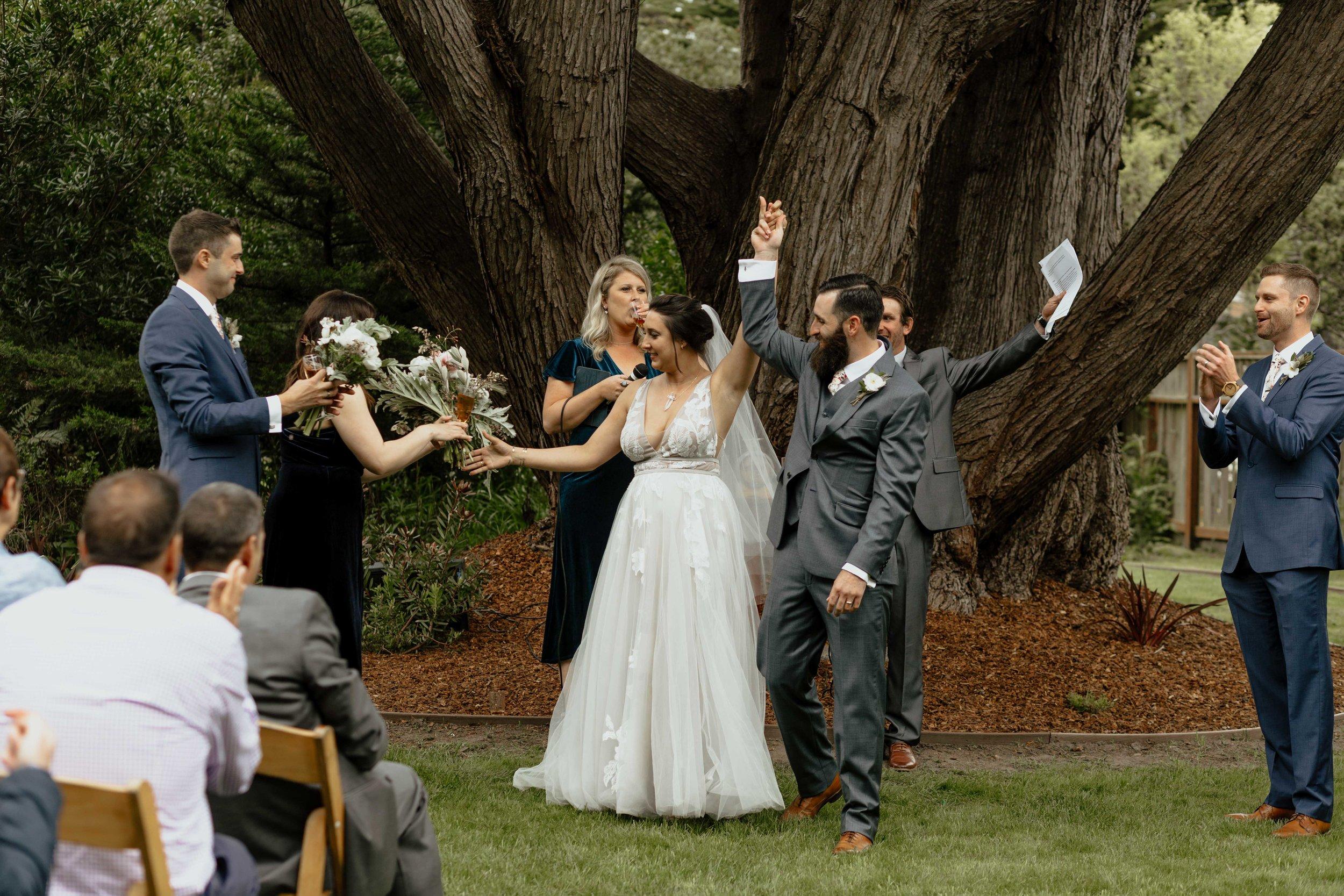 happy couple wedding ceremony spokane bridal shop