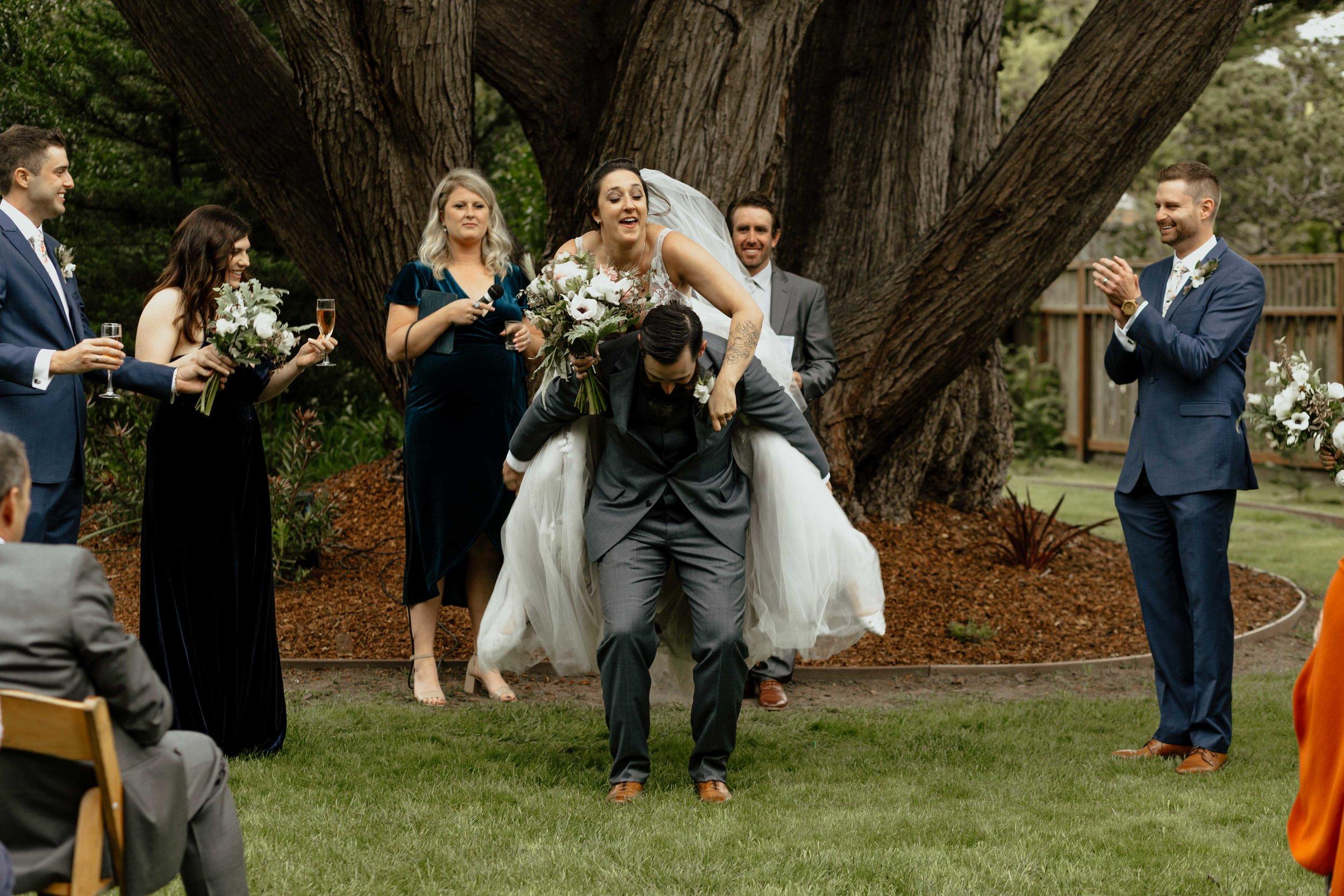 cute happy couple leaving ceremony spokane bridal