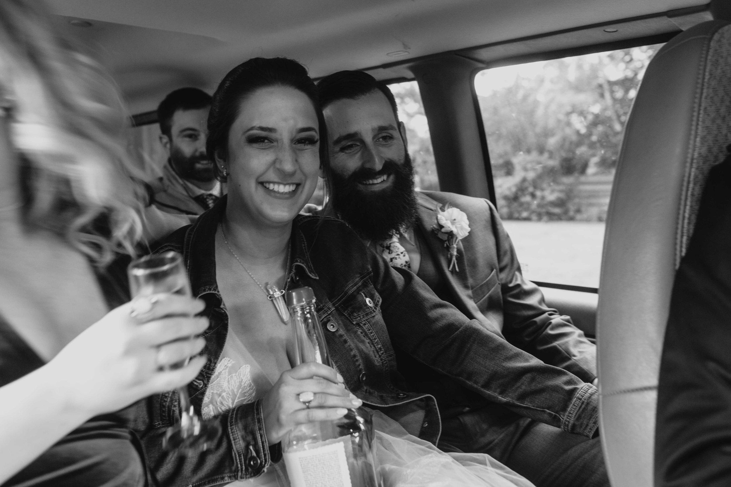 happy couple driving to dinner spokane bride