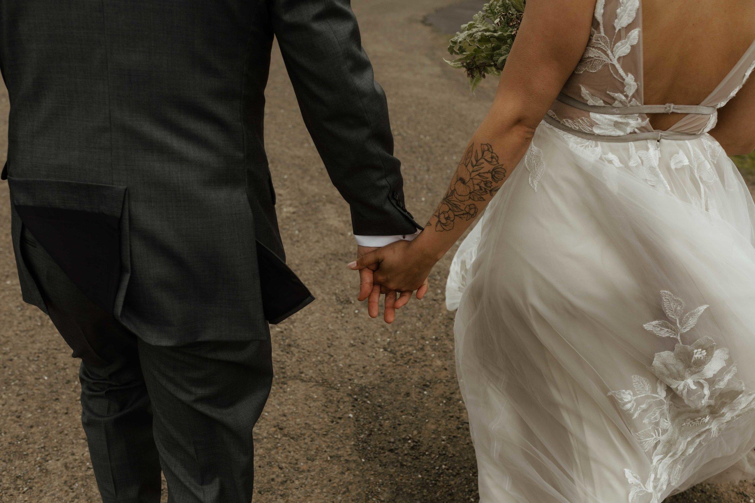 bride and groom running away together spokane wedding