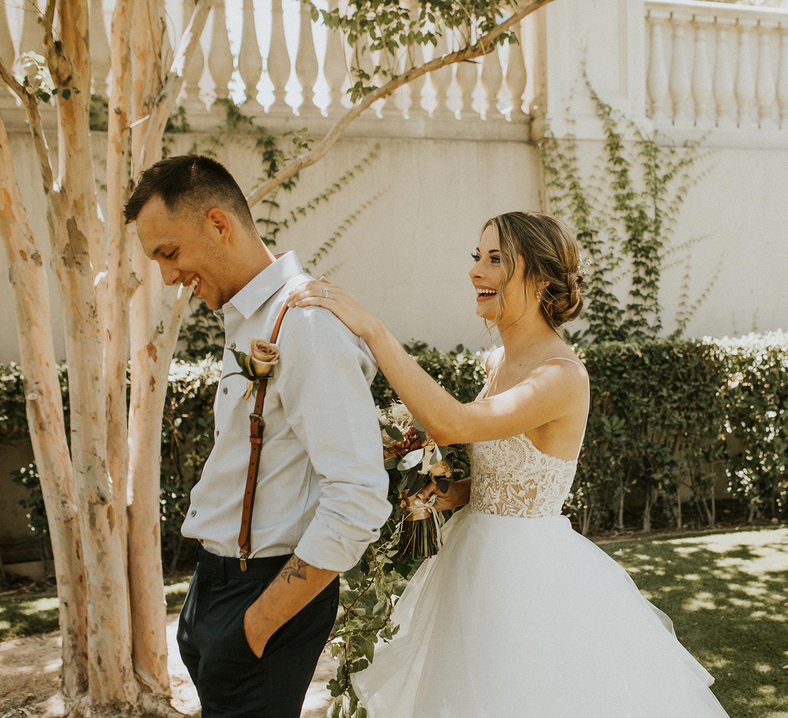 first look tap on shoulder spokane bride and groom