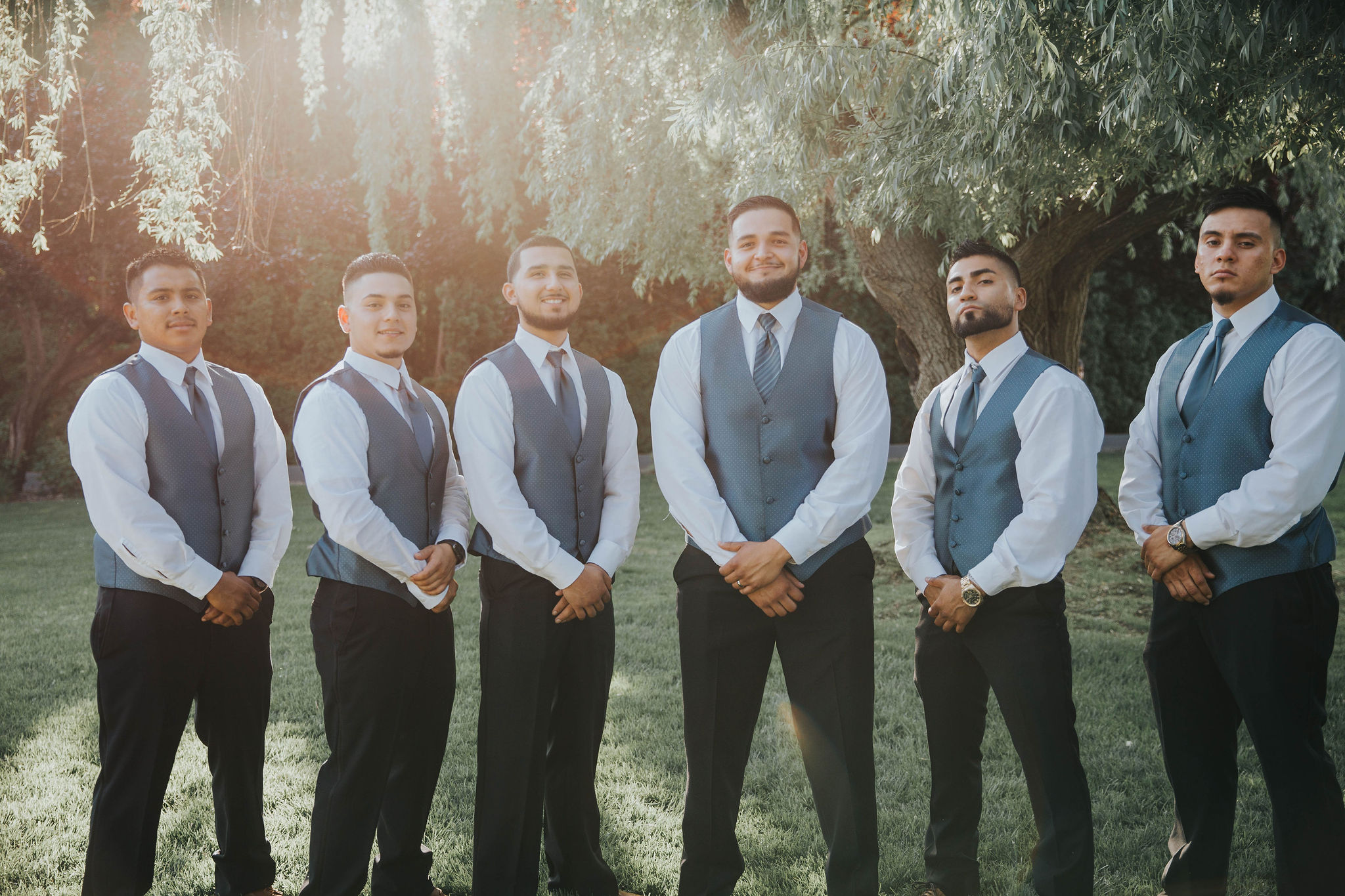 groomsmen tough pose spokane wedding bride