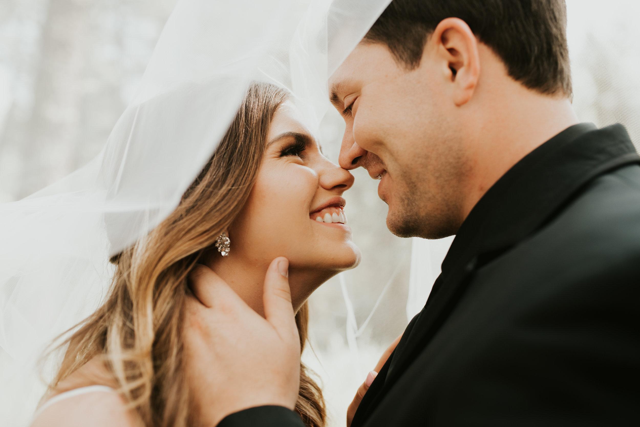 bride and groom under veil spokane wedding