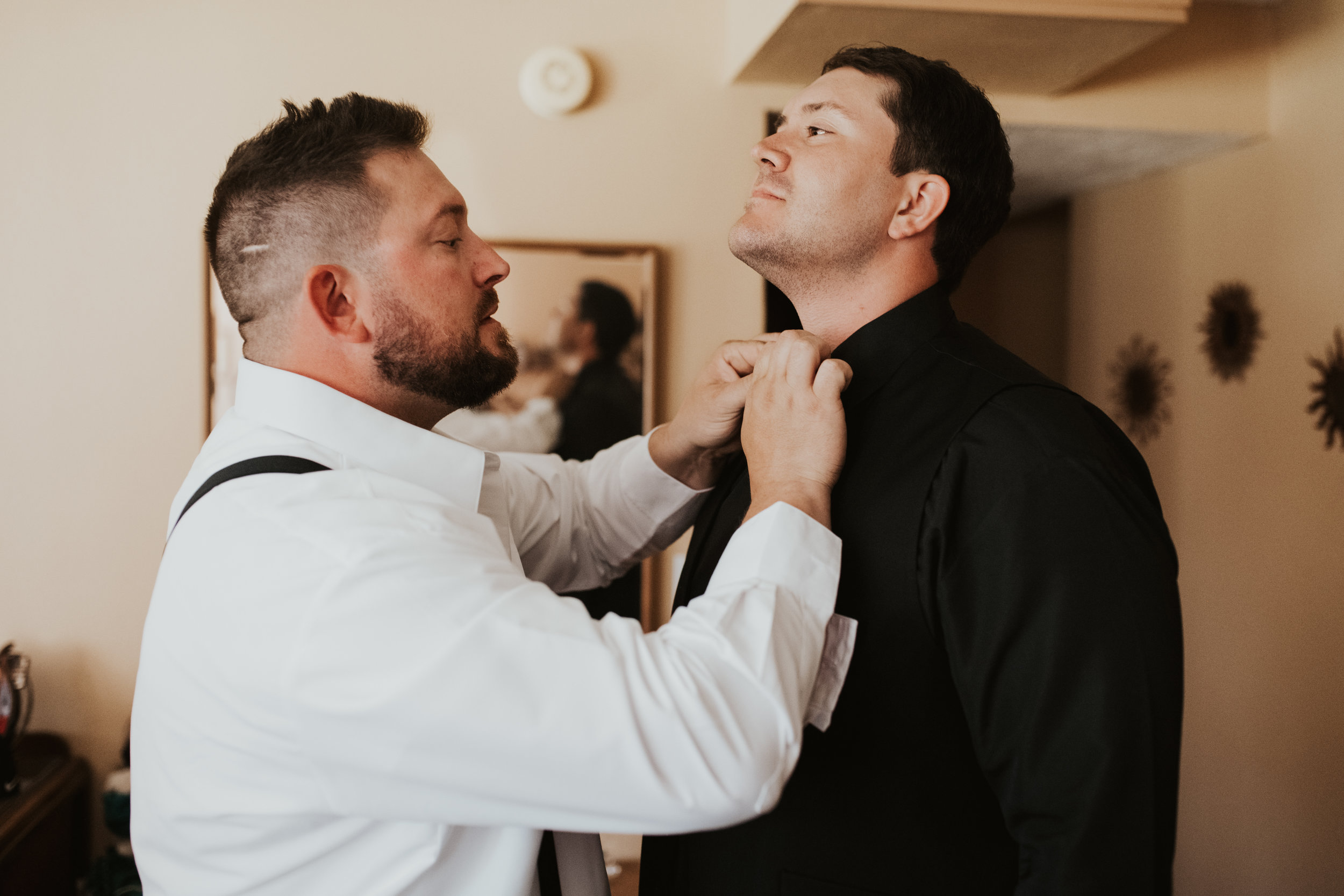 groomsmen hanging out getting ready spokane wedding