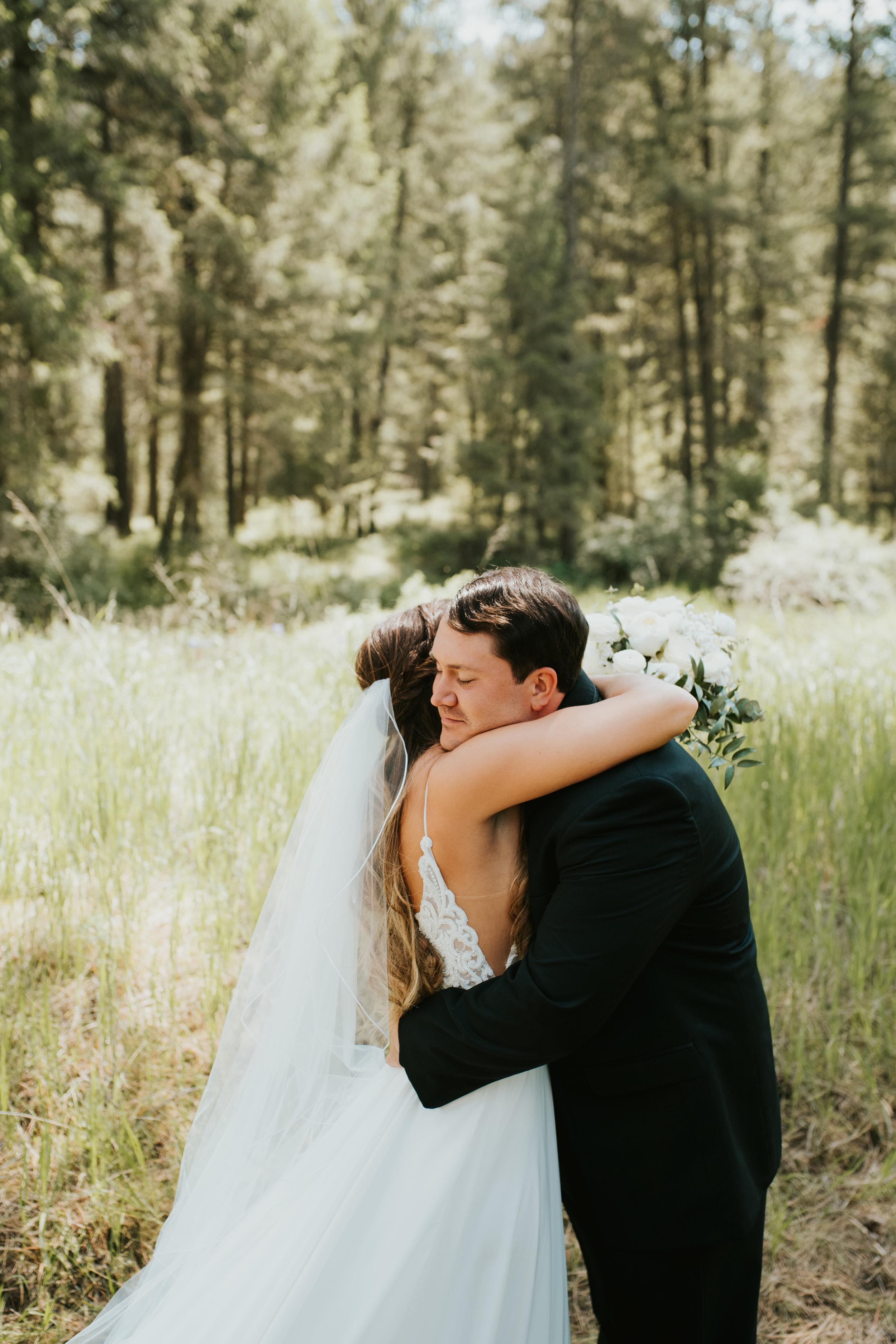 bride and groom hug spokane wedding
