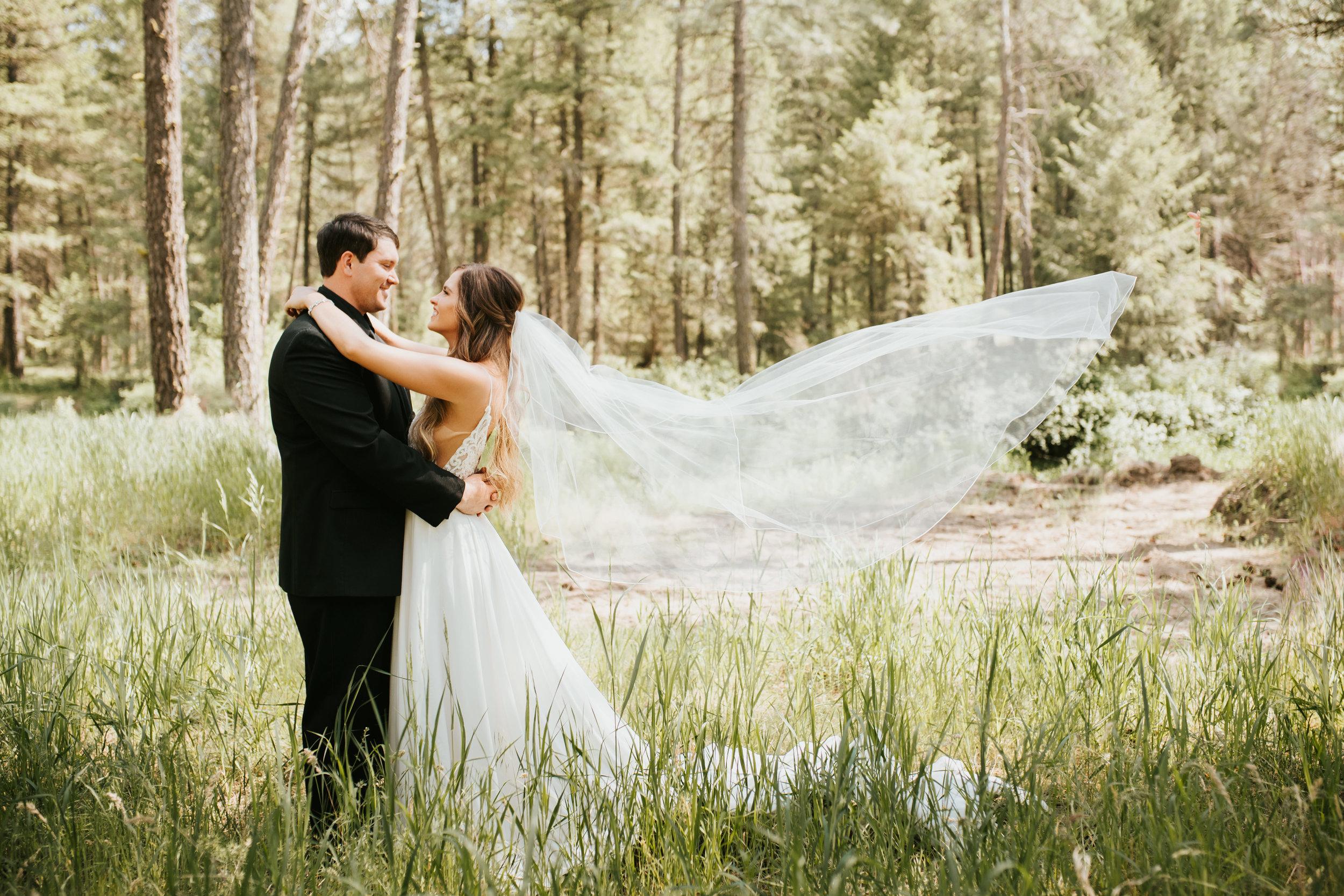 bride and groom long veil spokane wedding