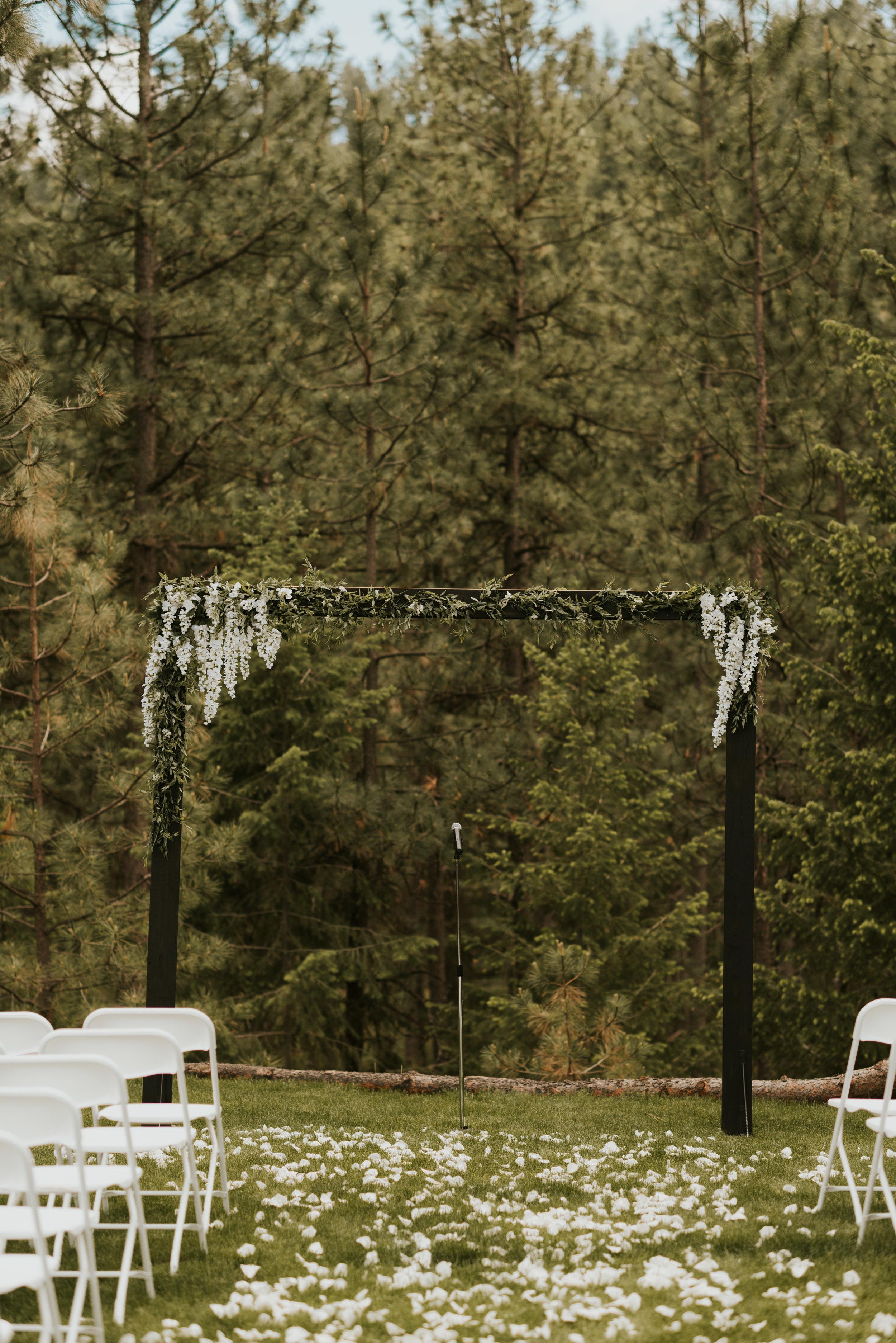 ceremony twinkle lights outdoor spokane wedding