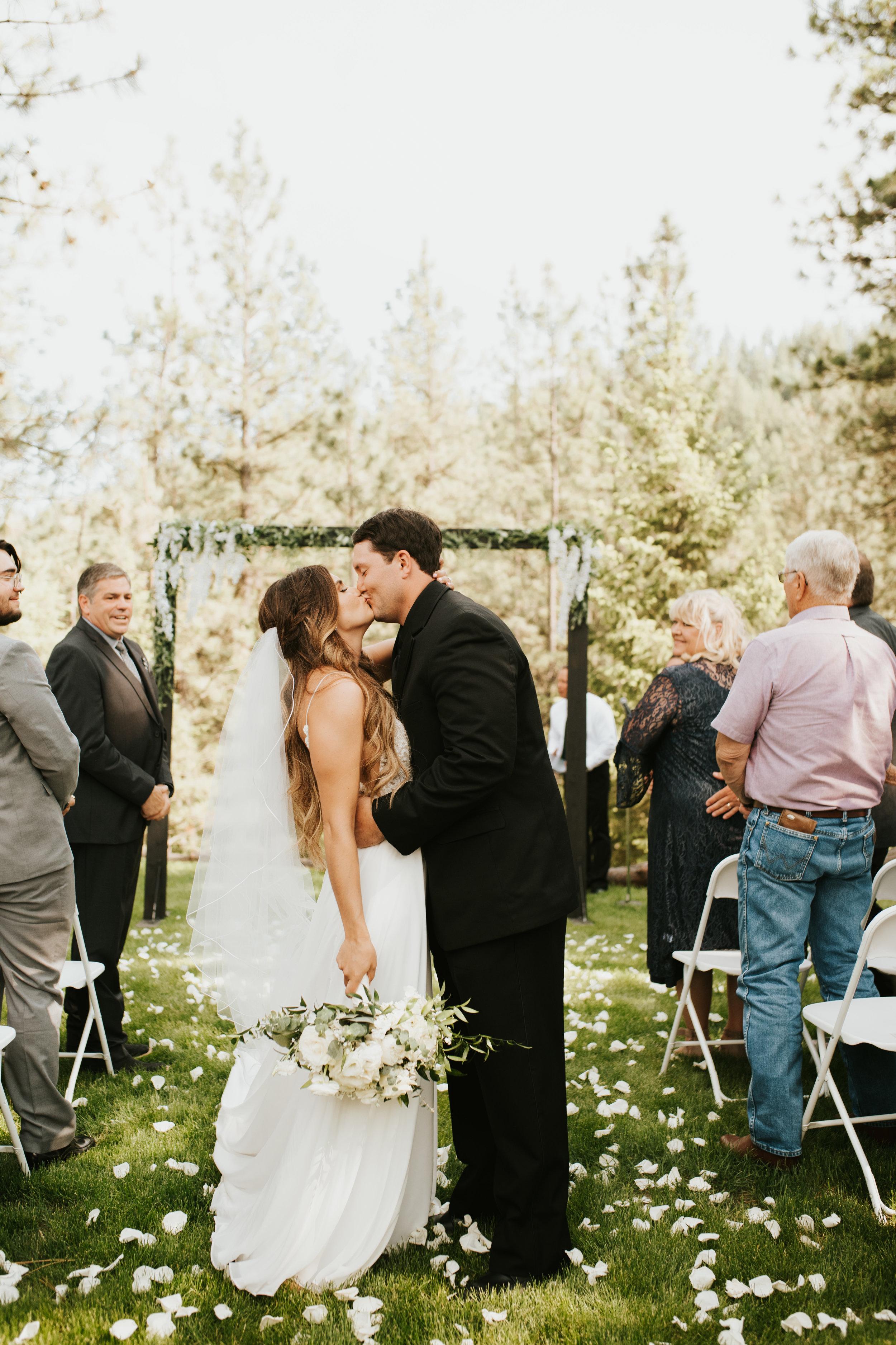 kissing newlyweds spokane wedding