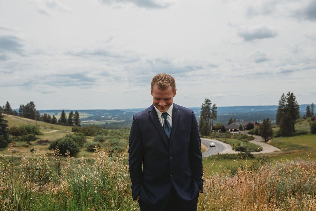 groom waiting for bride first look spokane wedding