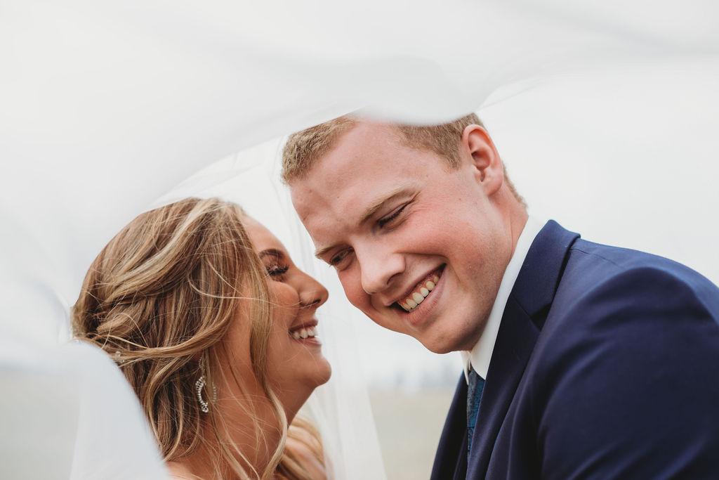 beautiful bride and groom laughing spokane wedding