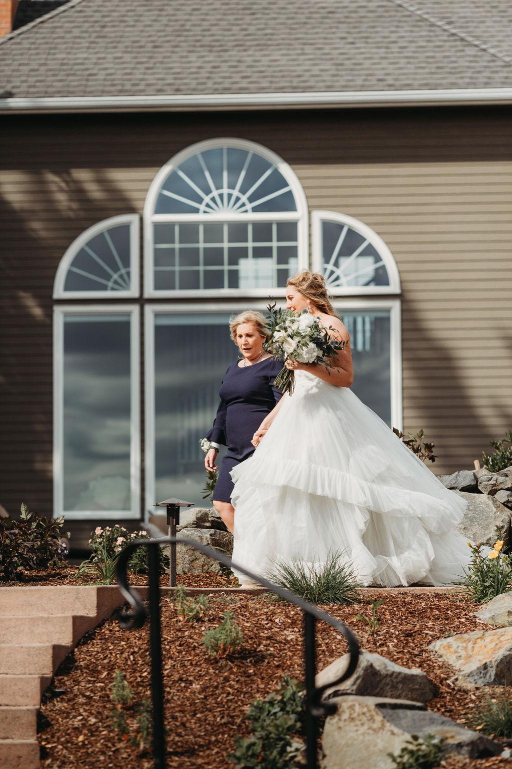 mom walking bride down the aisle spokane wedding