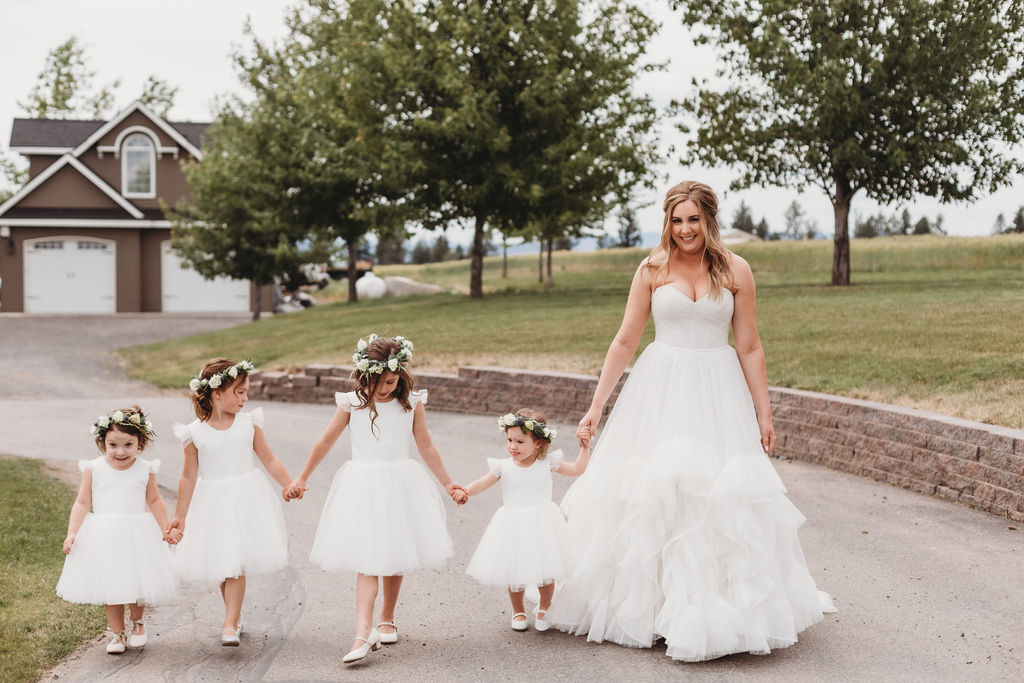 flower girls and bride walking spokane greenbluff wedding