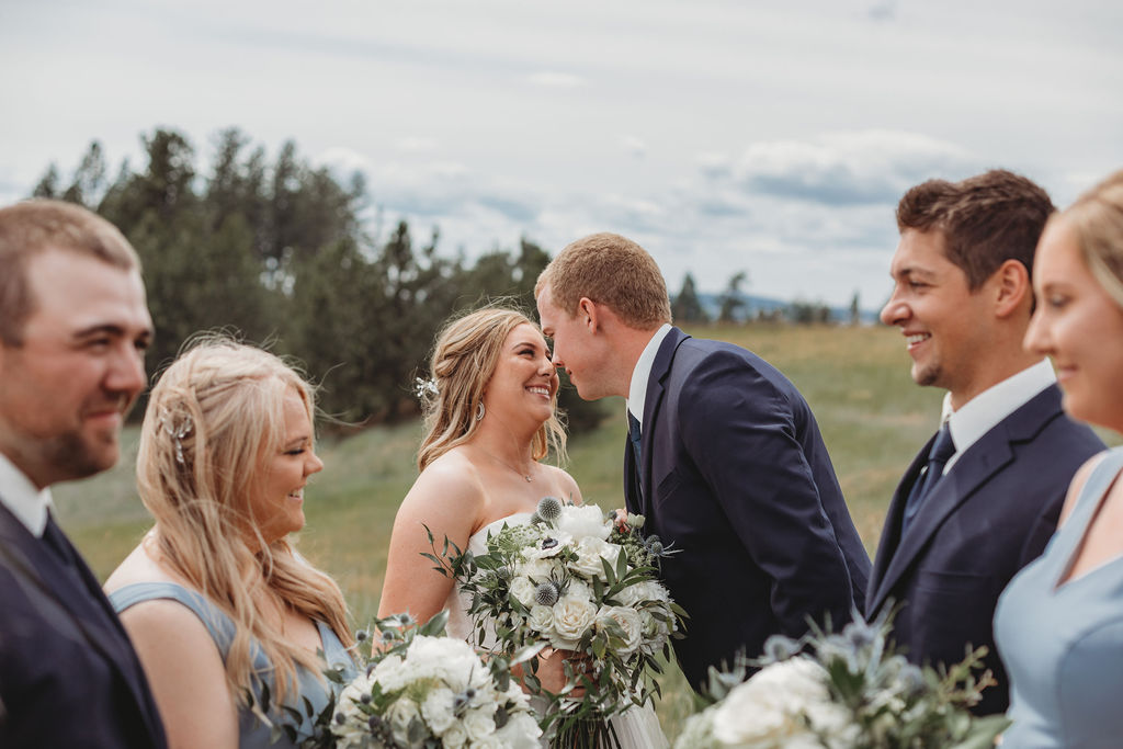 bride and groom together with bridal party spokane wedding
