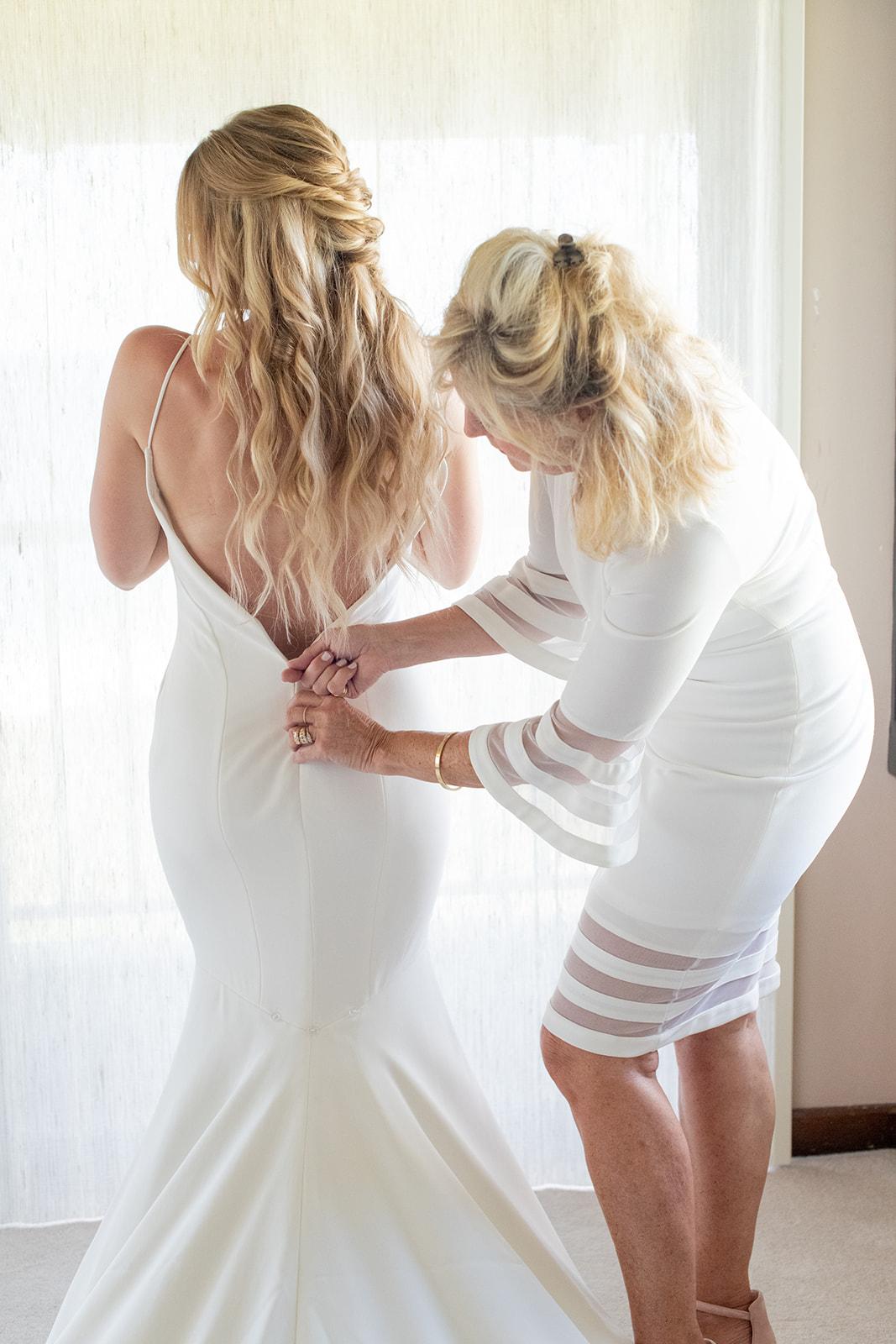 mom zipping up wedding dress spokane bride