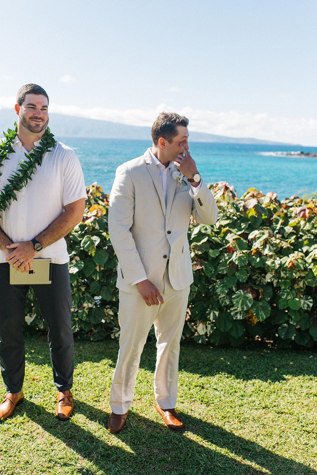 groom sees bride first look ceremony beach spokane