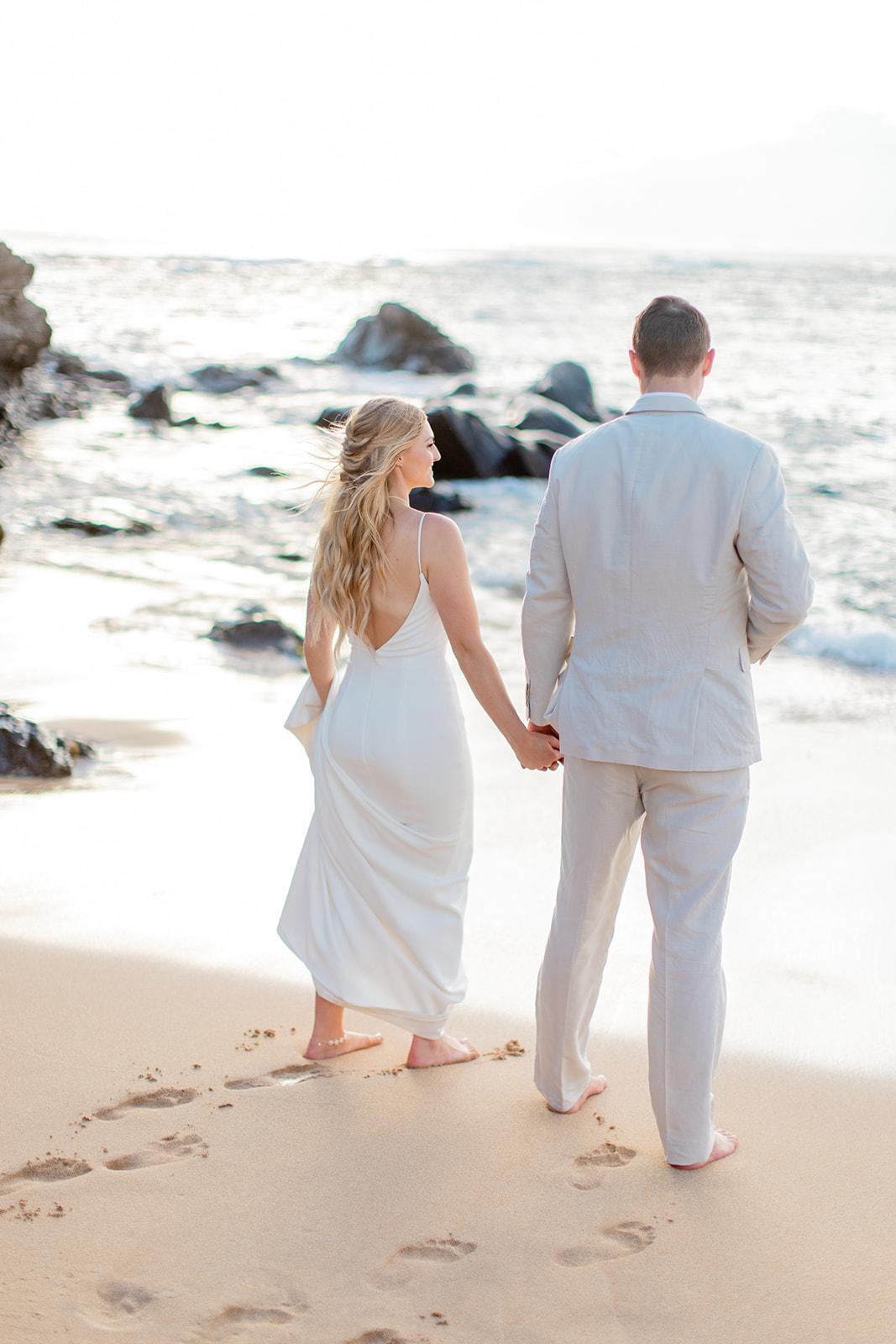 beach shot hawaii wedding spokane bride and groom